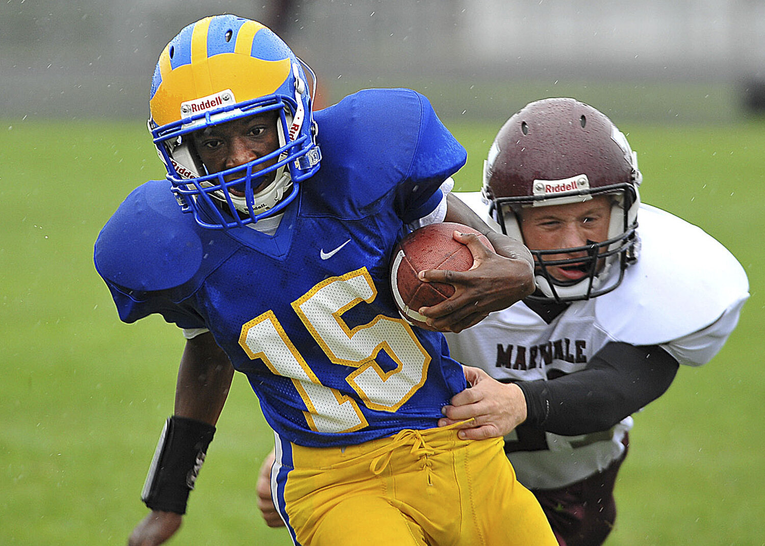 Golden Eagles Anthony Sullivan breaks a tackle from Flyers Michael Cammarano as Clev-Hill beats Maryvale 14-0 at Clev-Hill High School.