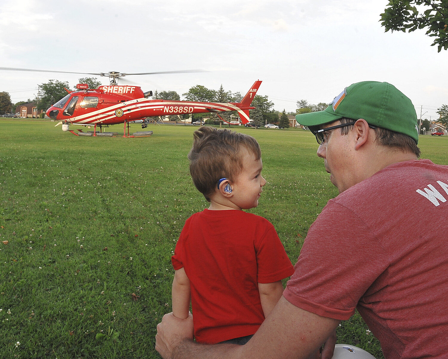 Two-year-old Connor Reagan gets excited with his dad, John as the Erie County Sheriff's Department helicopter perpares to take off during National Night Out at Cheektowaga Town Park