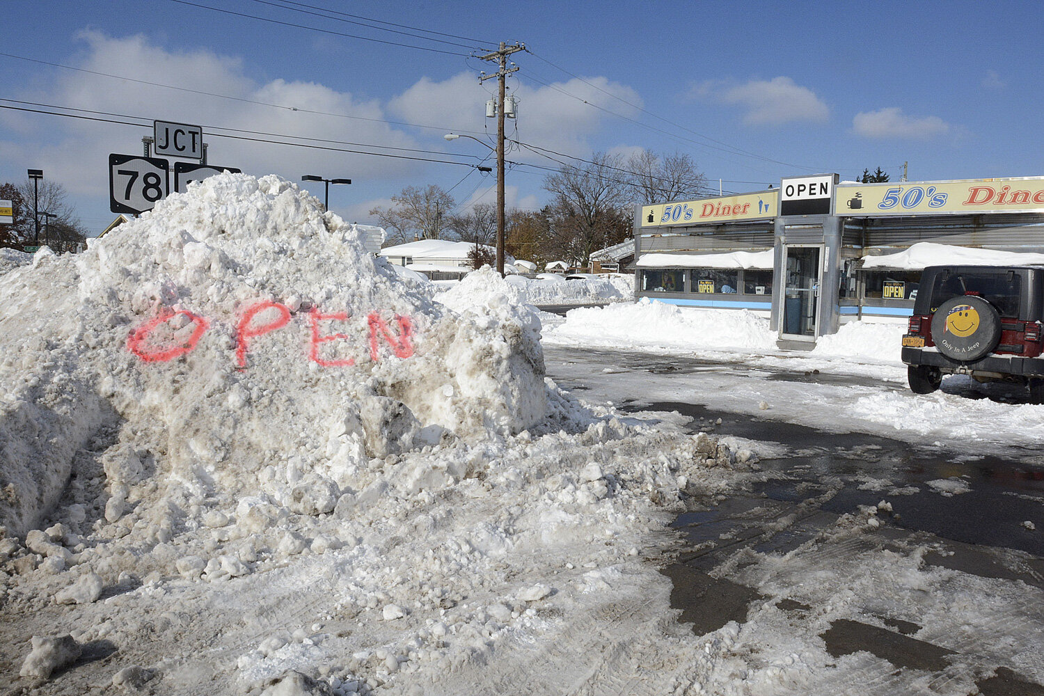 50's Diner used the mountain of snow in front of the restaurant to let people know that they were open on Friday as the first reprieve from the relentless storm that battered the area for four days.