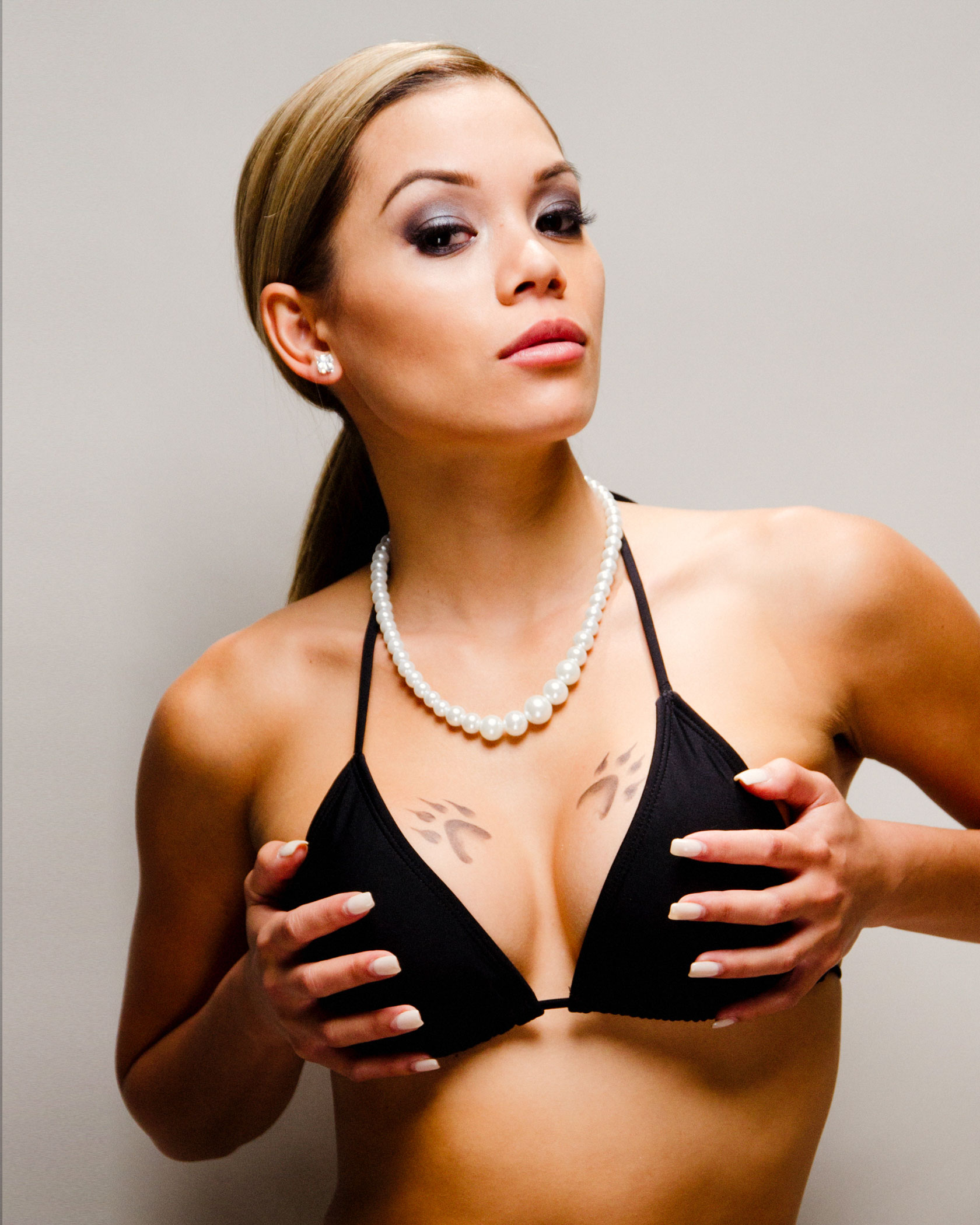 """""""I know you love flossing with X, busting them checks, getting tattoos - paw prints on your chest"""" - Philly, Philly (""""Ruff Ryders' First Lady"""" 1999). Paw print tattoos - """"I just think it's a form of expression, just like going in the studio, writing a song,"""" says Eve about tattooing. She had wanted paw prints for a tattoo but having them inked on her chest was originally posed as a dare by a friend. """"Now that's how people recognize me."""" -  Eve """"Billboard's Marked Up"""" by Billboard Staff on Billboard 03.26.13 / from Philadelphia PA"""