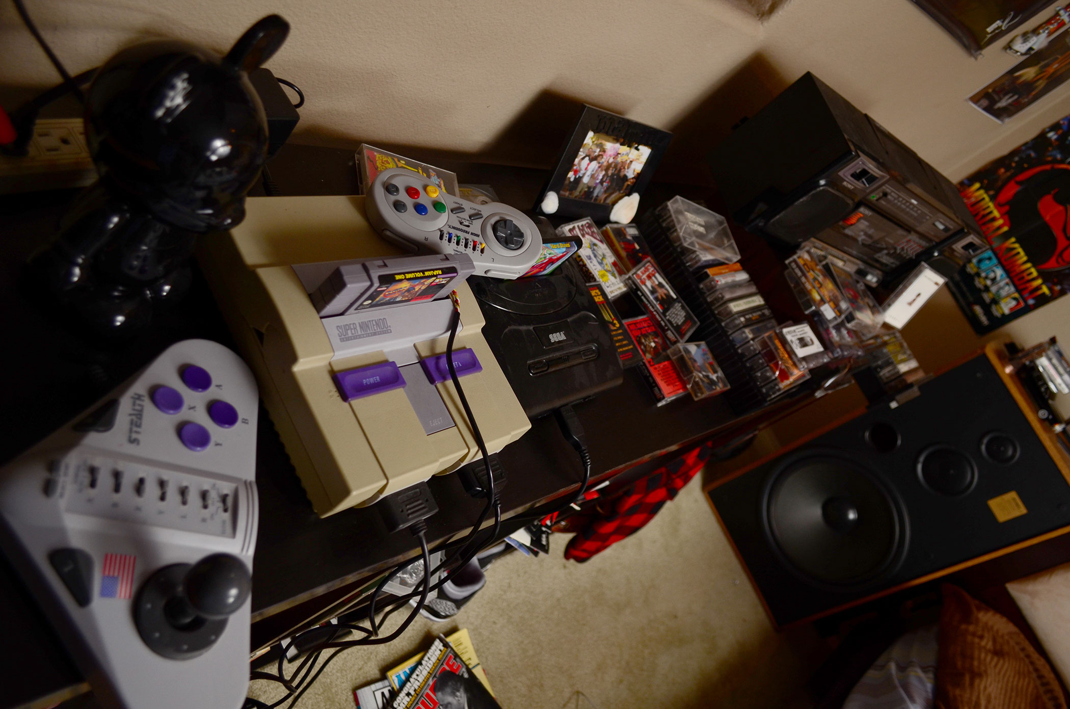 """""""Super Nintendo, Sega Genesis"""". For our shoot, """"Rap Jam: Volume One"""" for the Super Nintendo plays on the television. The game featured rap and Hip-Hop artists playing street basketball."""