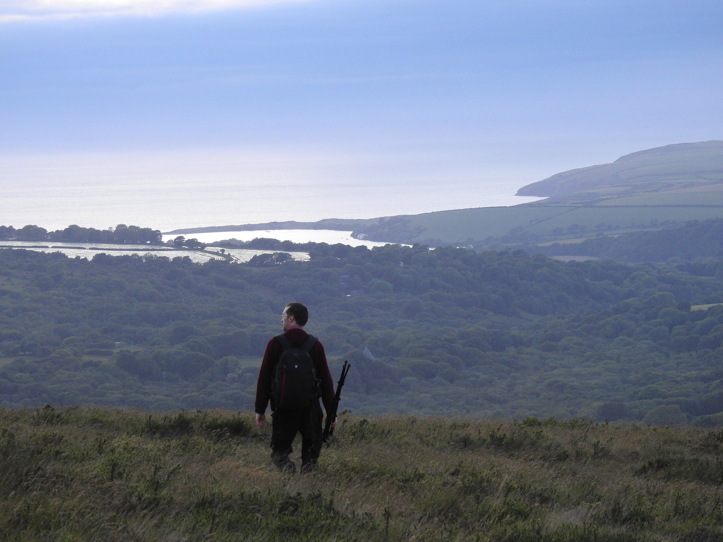 Hiking over the hills towards Nevern Estuary in Pembrokeshire, Wales.