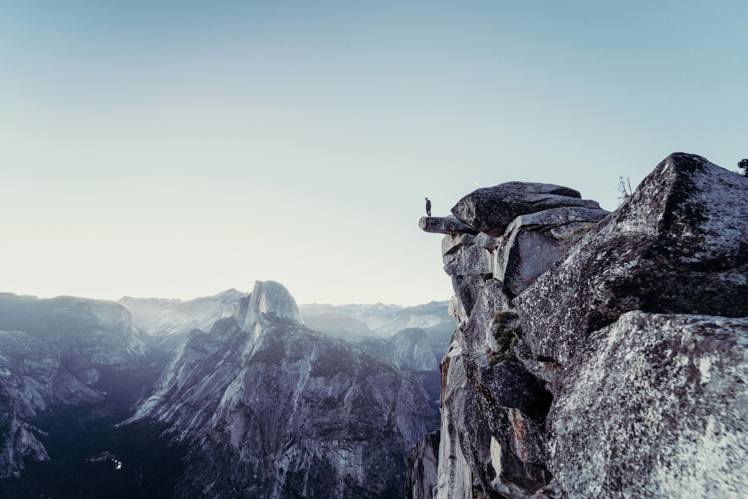 view of one person overlooking a canyon