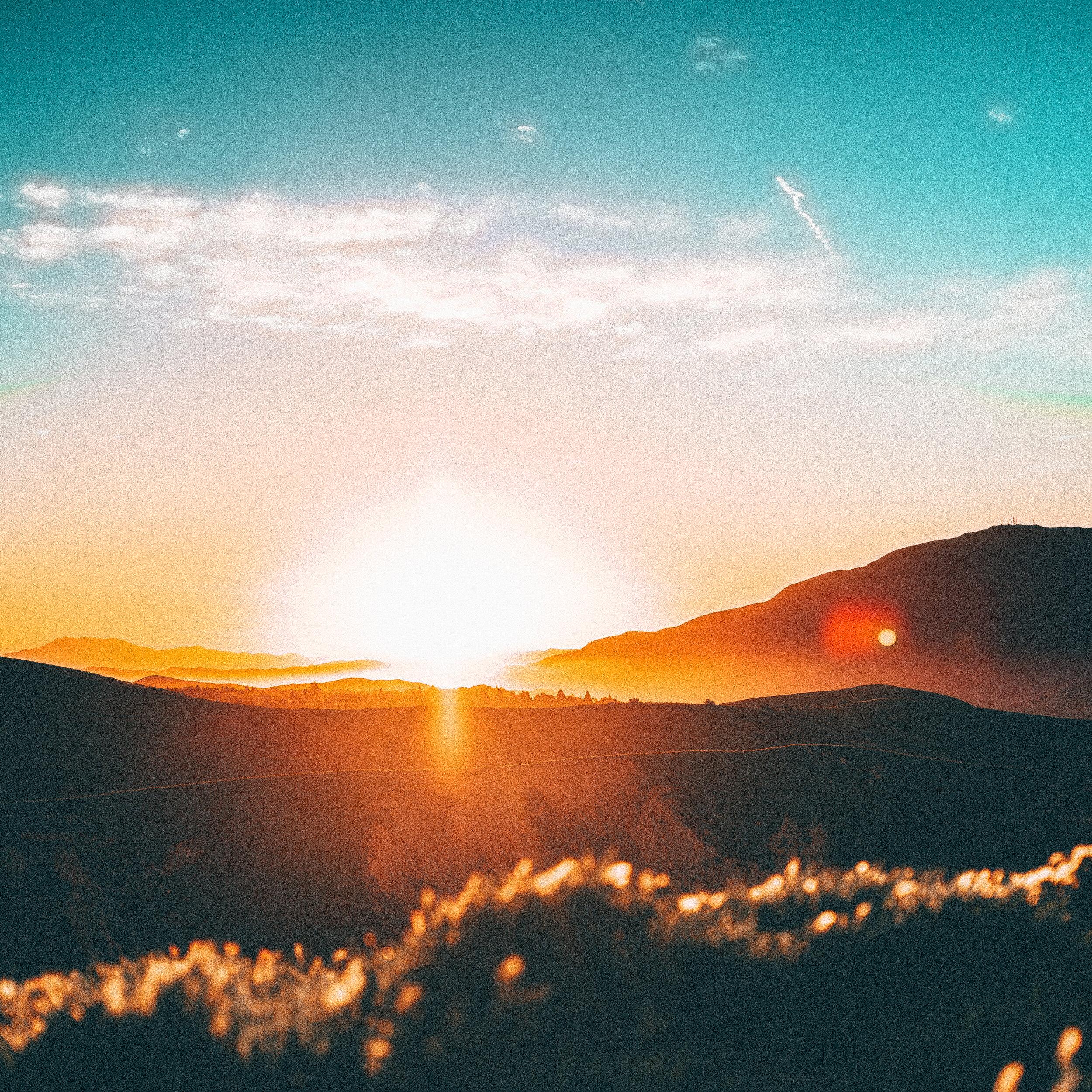 sun peaking over the horizon