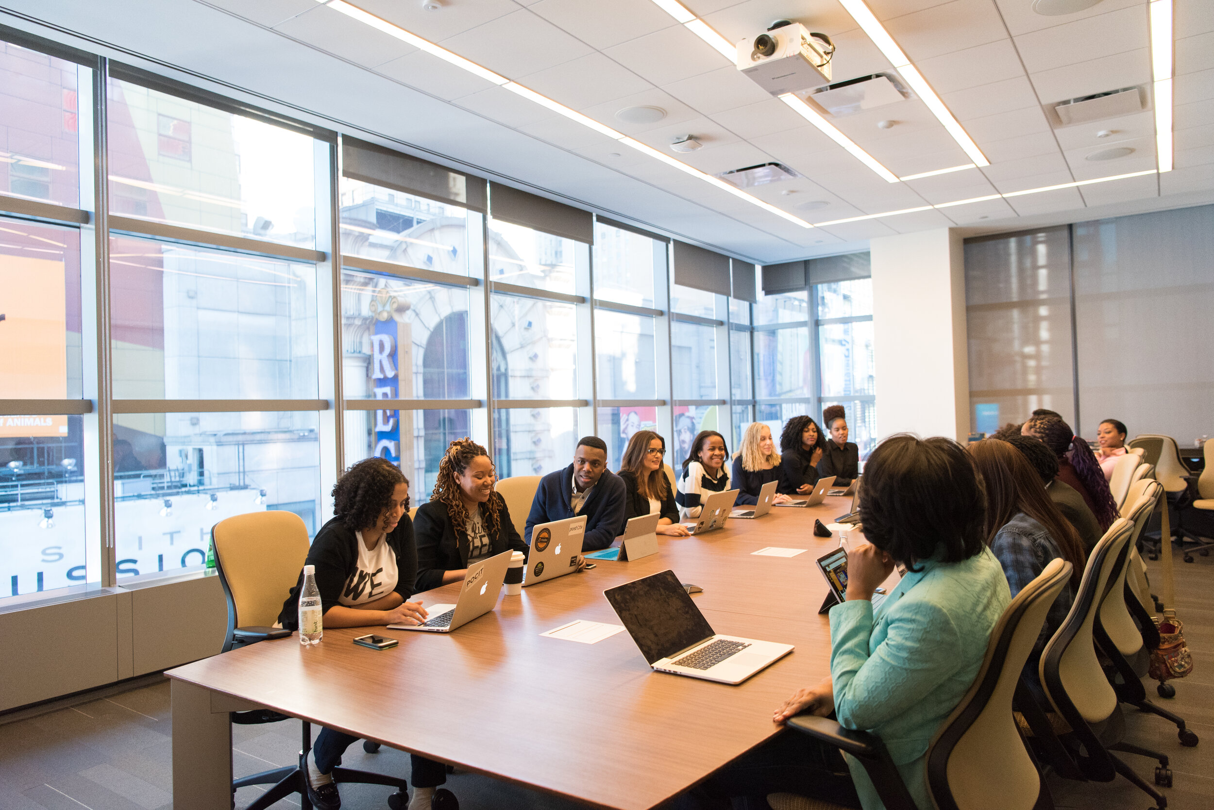 diverse group of employees sitting at a conference table