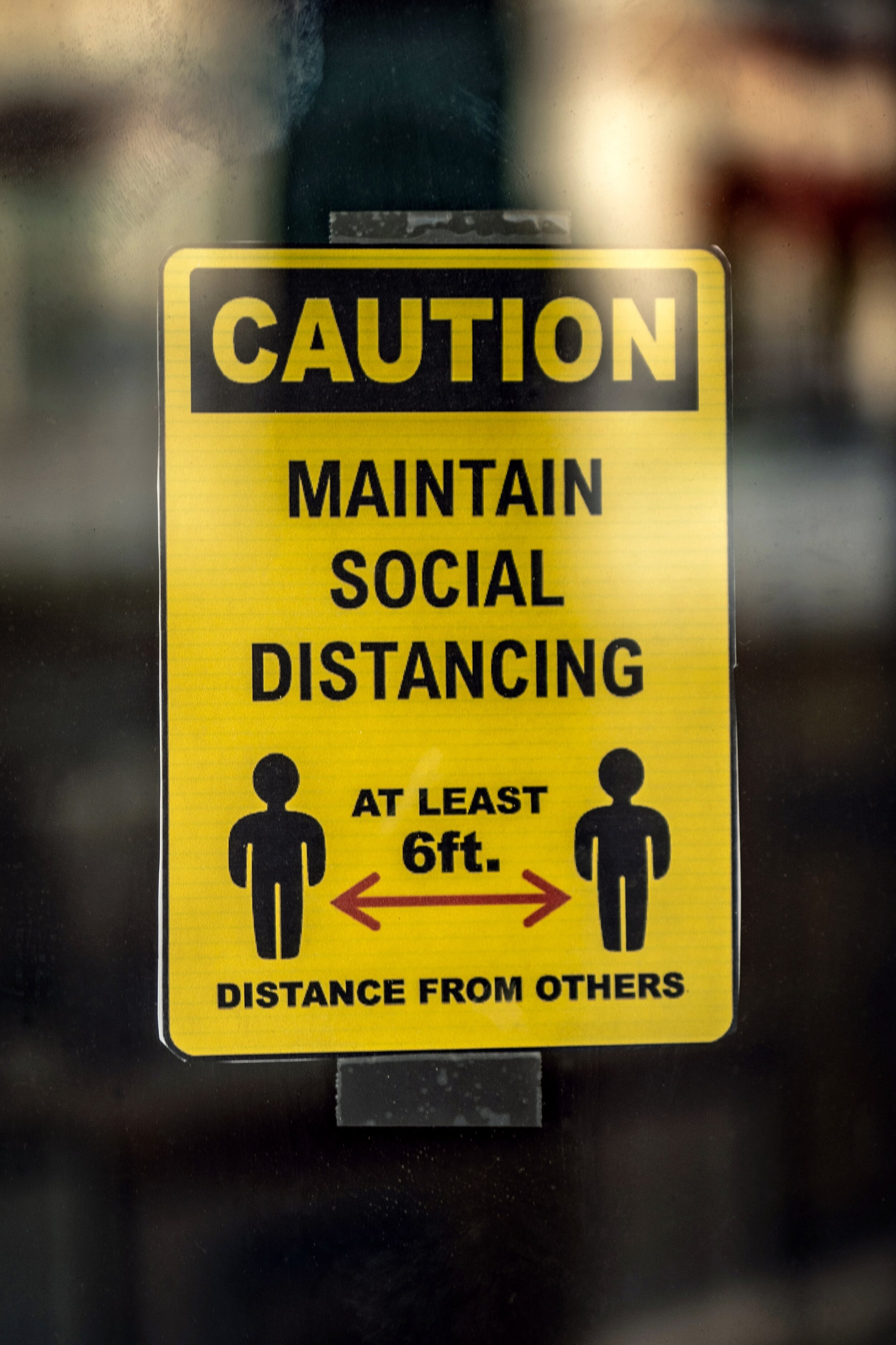 caution sign encouraging social distancing