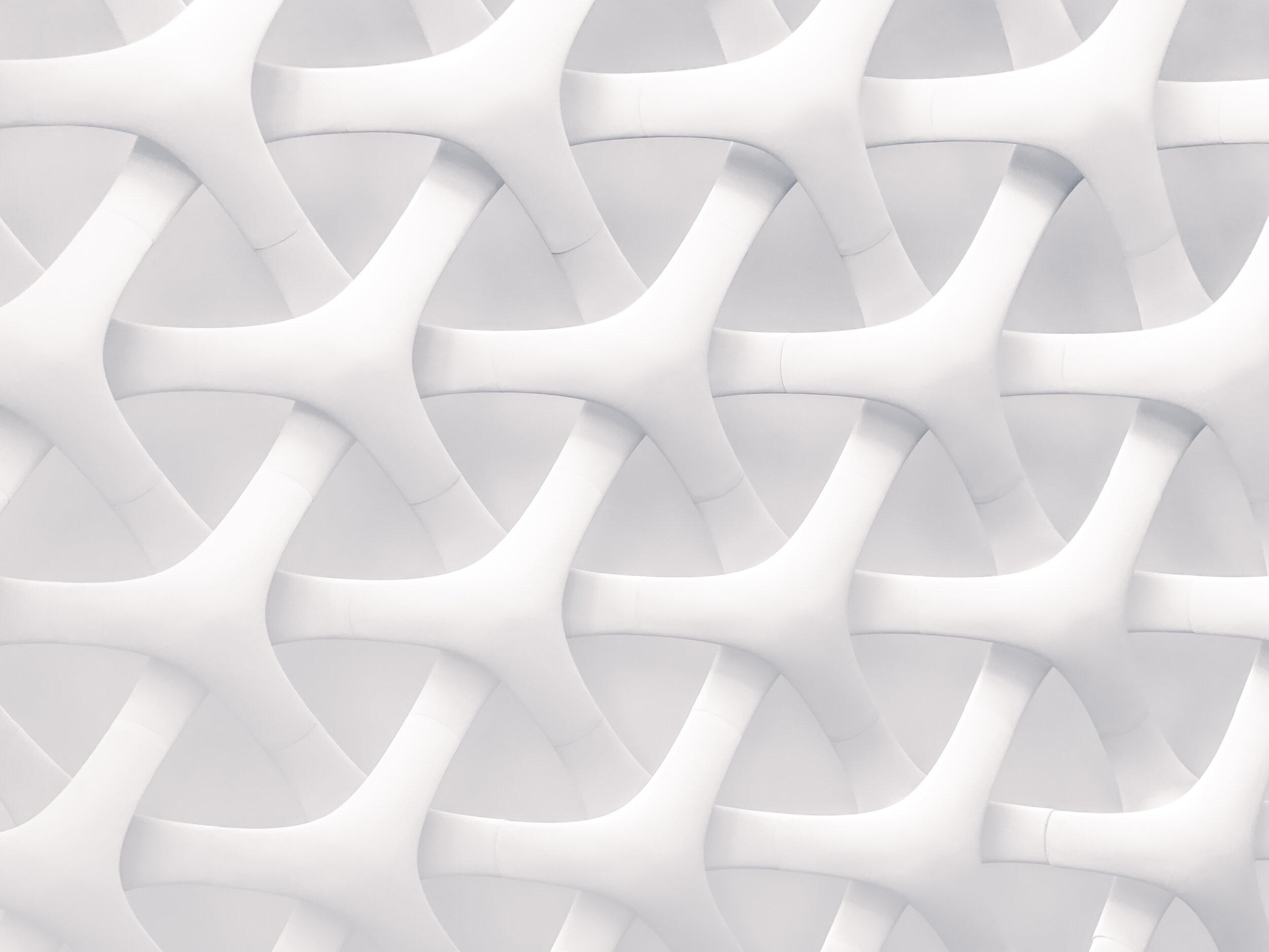 interlocked white shapes