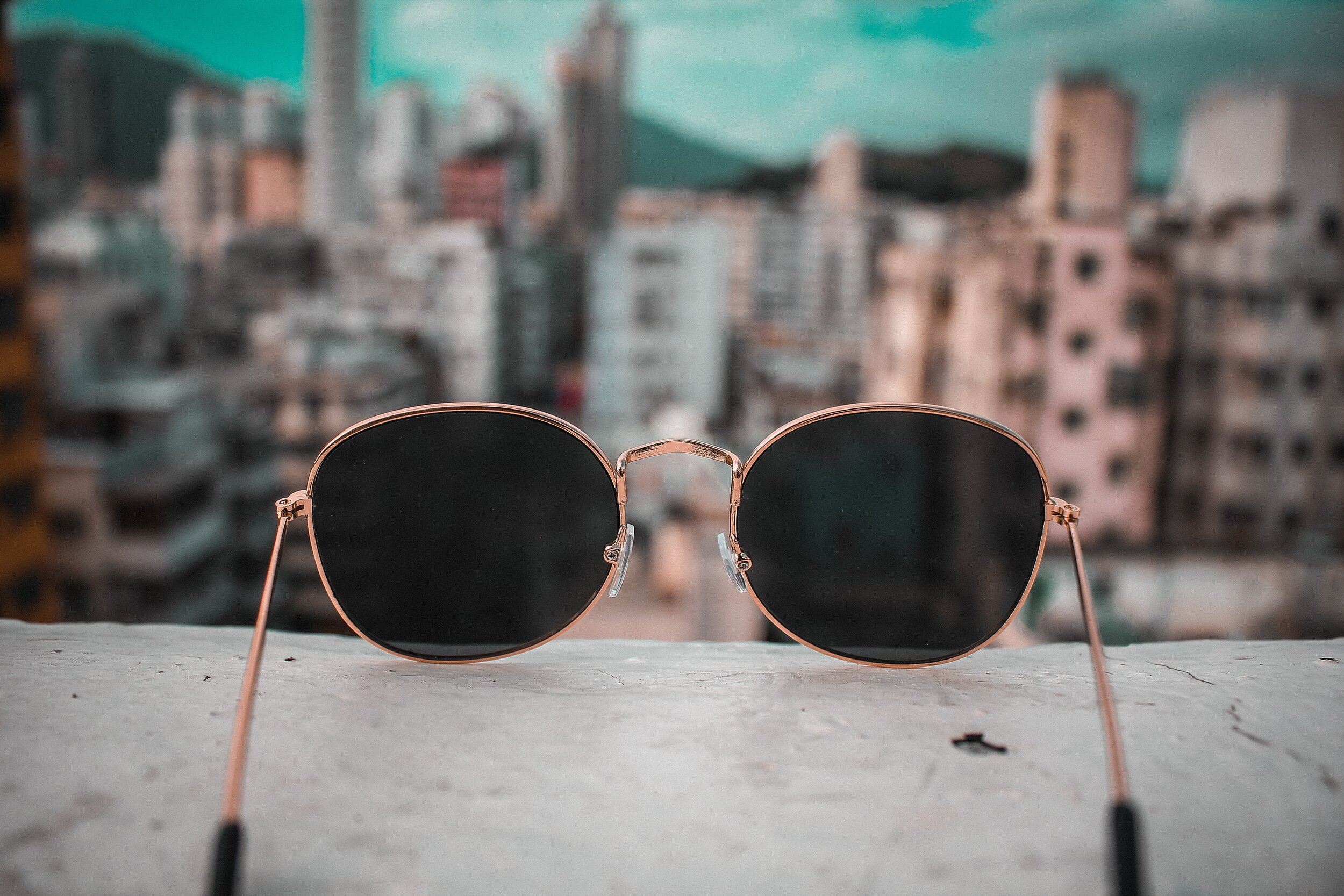 sunglasses with a blurred city view beyond them