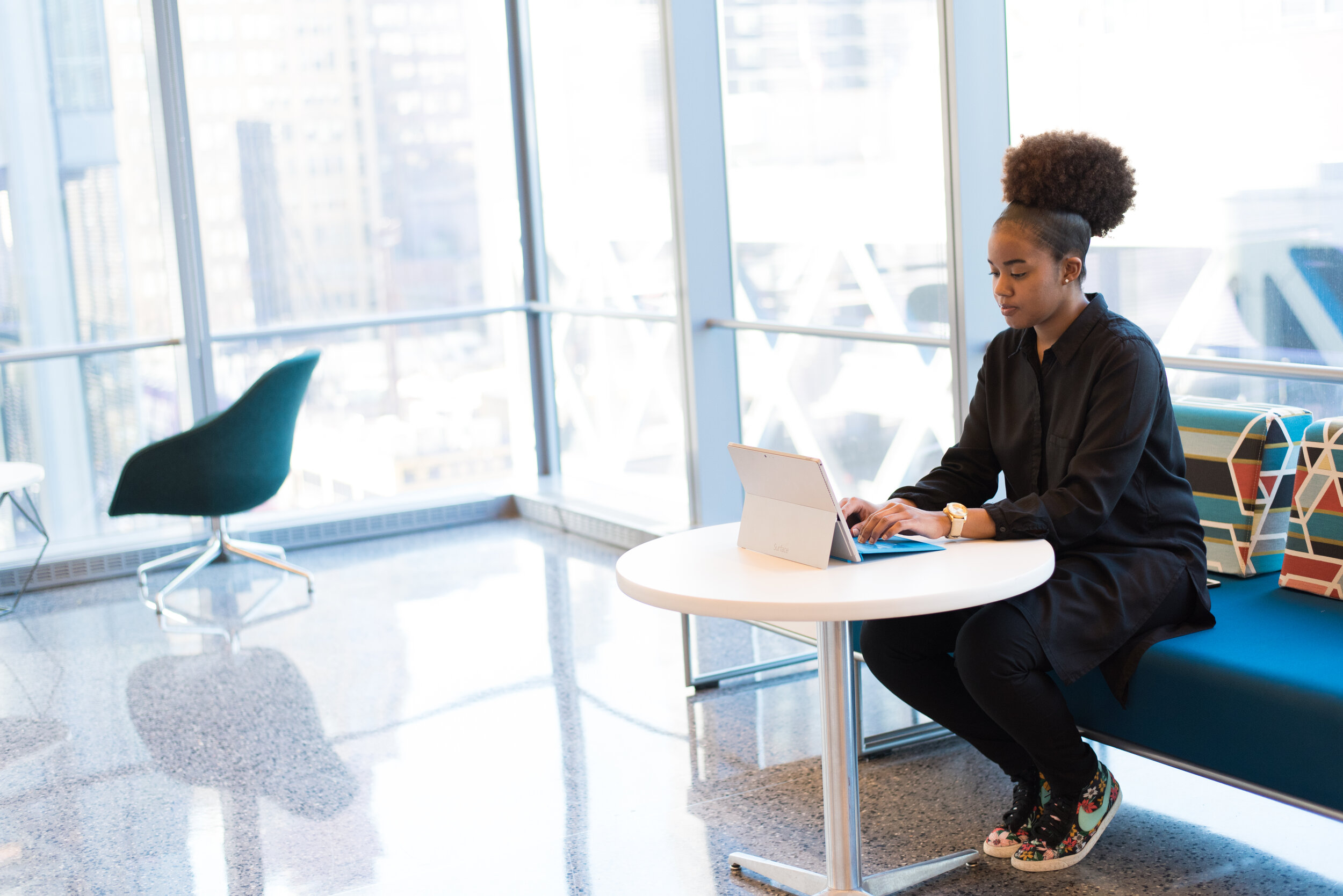 businesswoman sitting at a table in front of a laptop