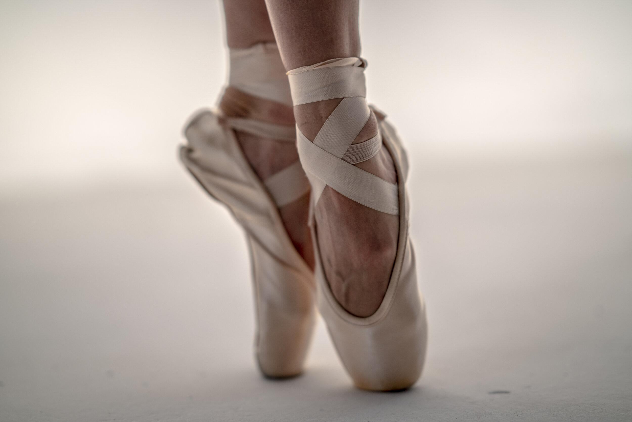 close-up of a ballet dancer's foot en pointe