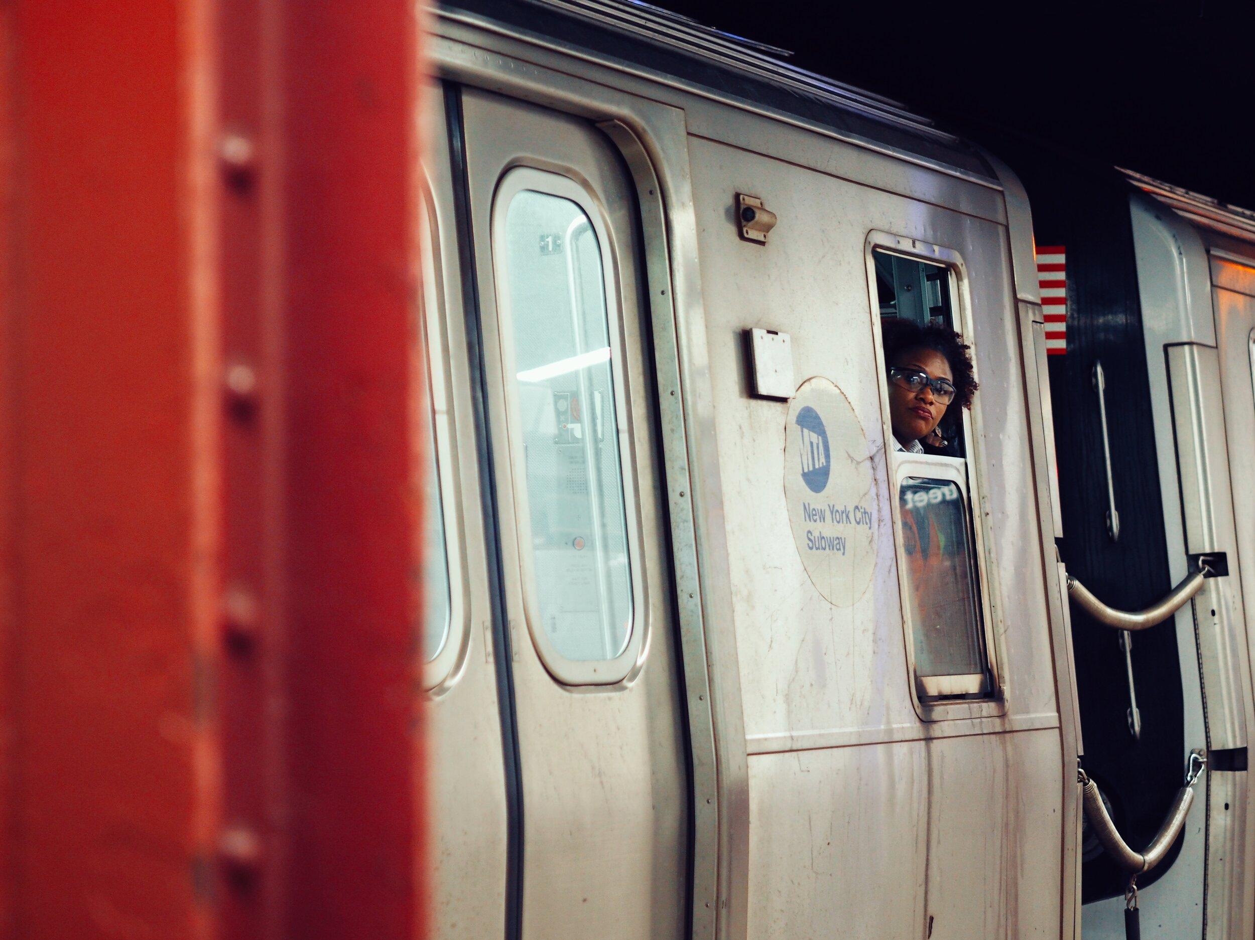 women looking out of train car window