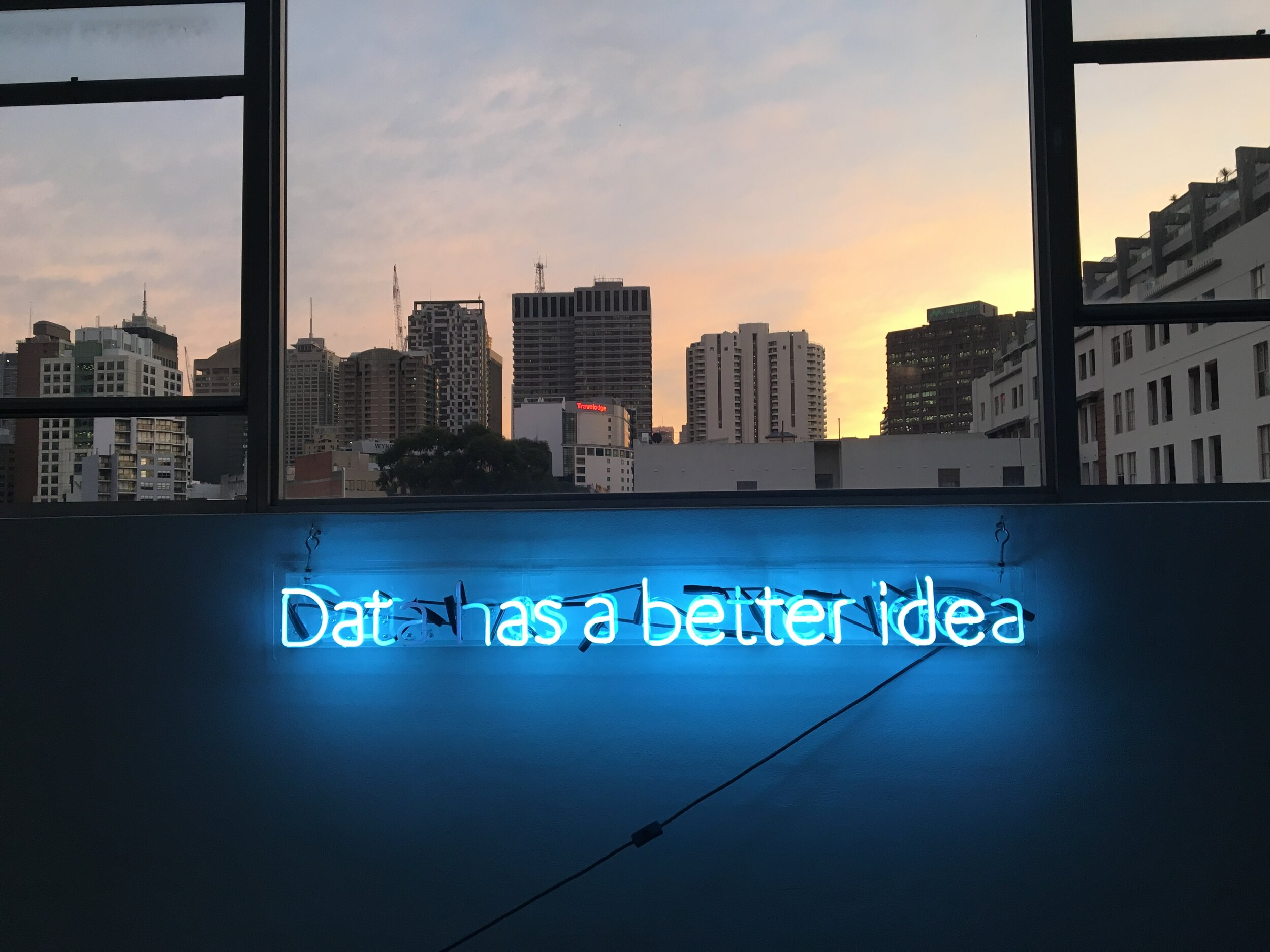 """glow in the dark sign that reads """"data has a better idea"""""""