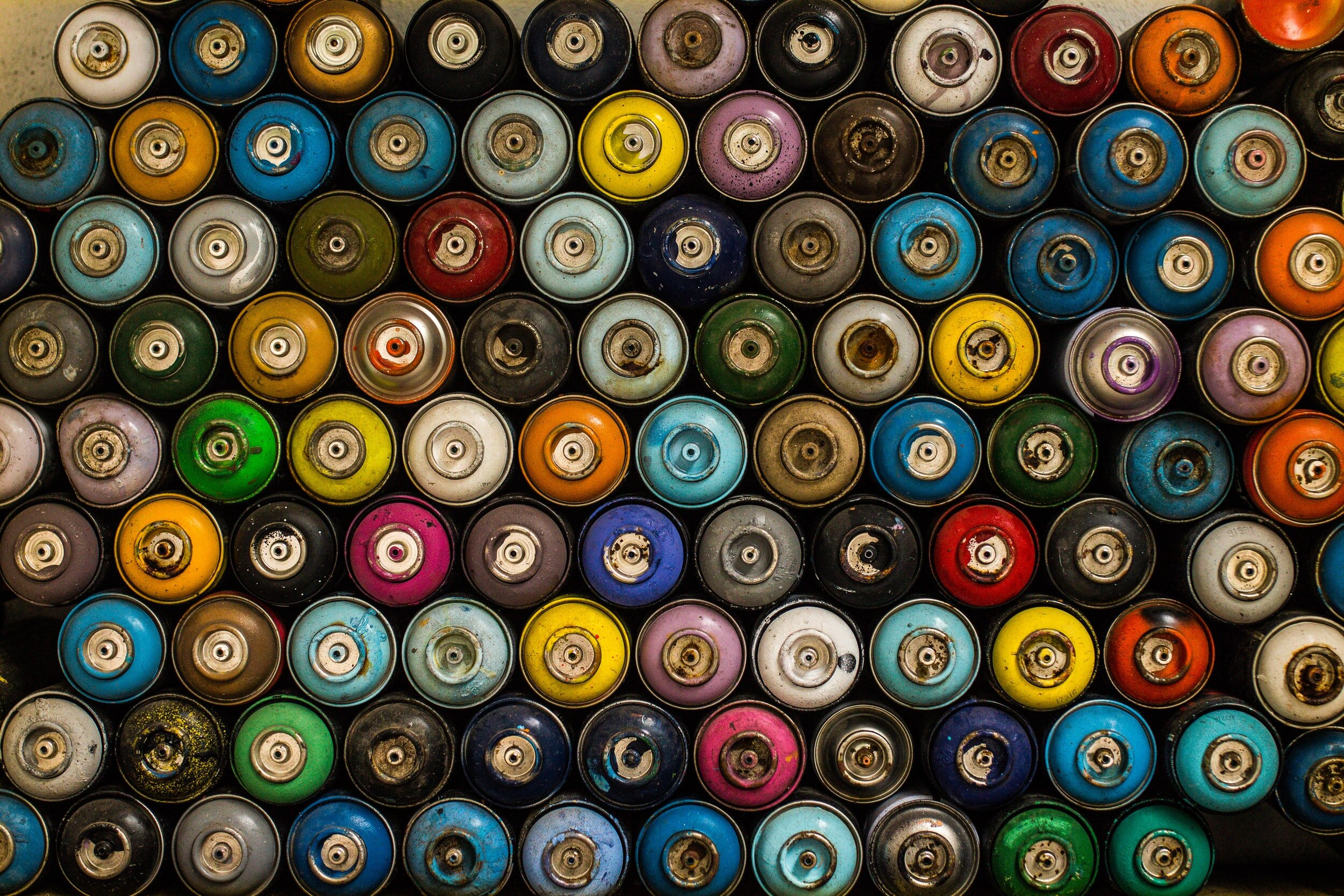varies colors of spray cans without lids