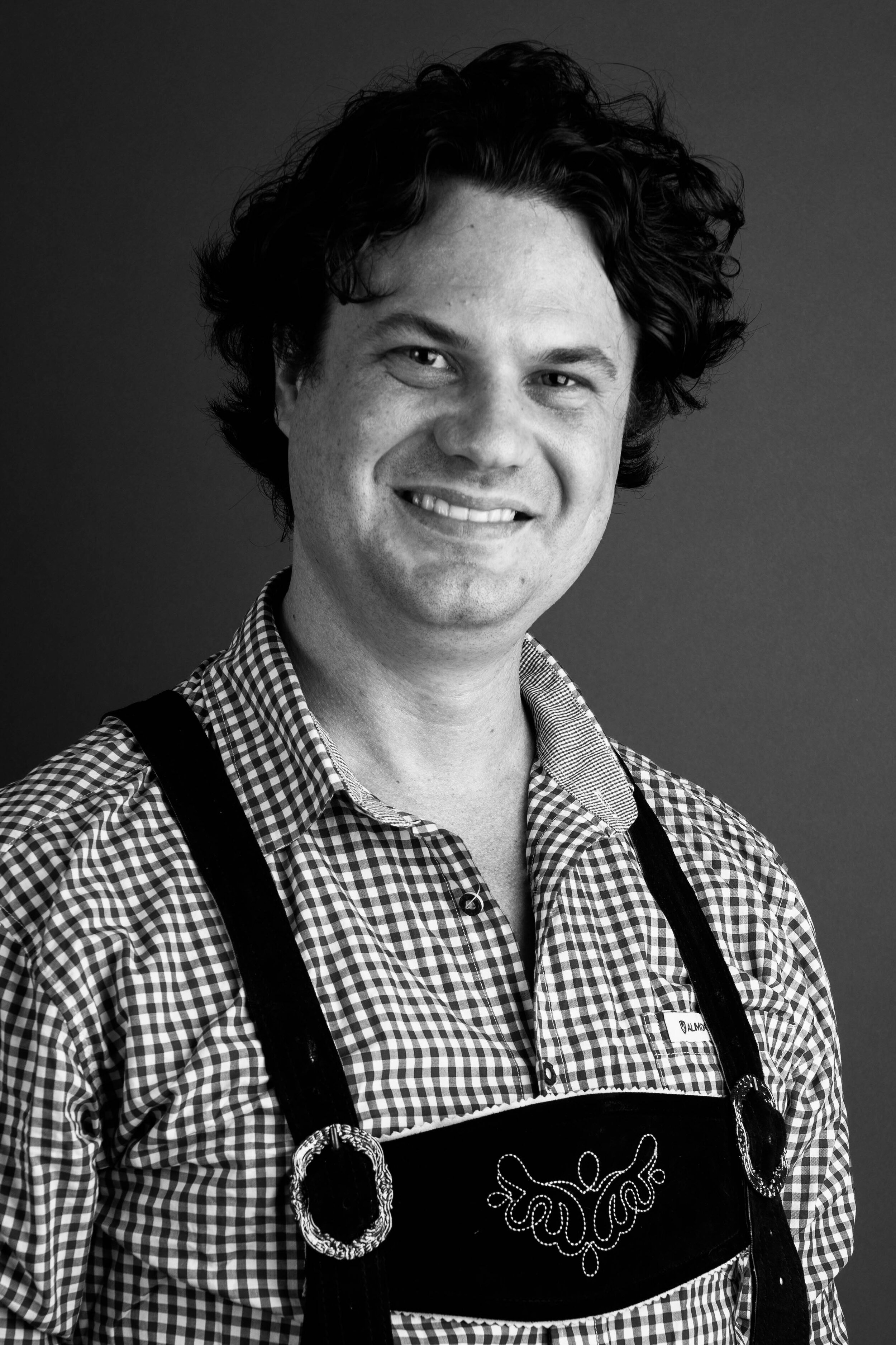 Simon Hilberding   With his signature untamed hair and love of BBQ's, Simon hails from Australia, because every band needs their token Aussie!