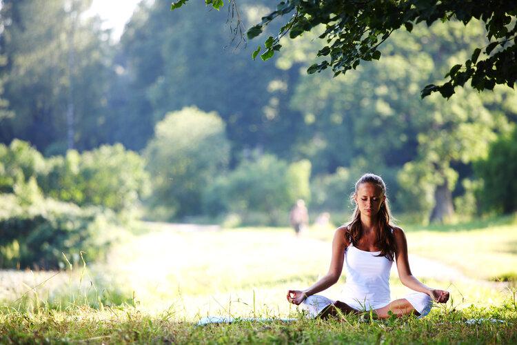 bigstock-yoga-woman-on-green-grass-12509738.jpg
