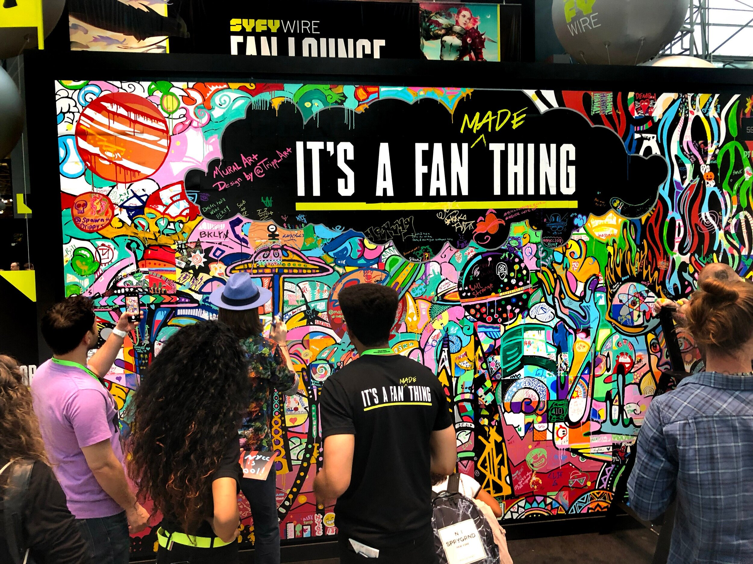 "Interactive Murals - In partnership with SYFY and NBC, Tripp and his team created a completely unique experience for the 400,000 New York Comic Con attendees over 4 days.Tripp created and executed a 400 piece interactive puzzle that changed designs each day. Attendees were able to choose their own 3""x 3"" tile and with Tripp's hands-on guidance were able to create a bigger picture."