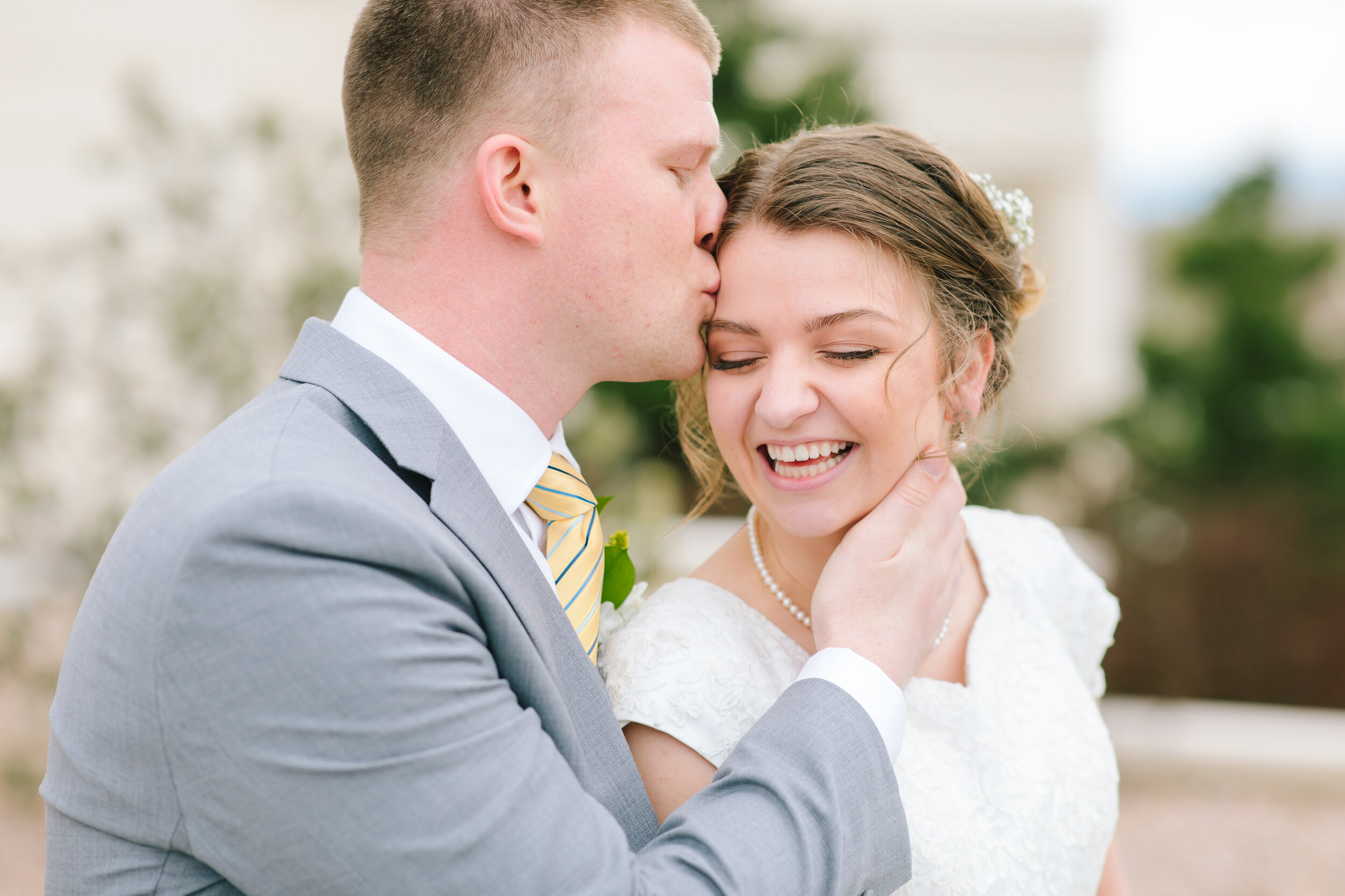 eternal best buddies professional utah photographer true love sealed for time and all eternity temple weddings lds bride forehead kiss pose happy couple yellow tie wedding color inspiration wedding hairstyle inspiration couple pose inspiration groom hairstyle #eternalbuddies #weddingsession #weddinginspo #ldswedding #ldsbride #couplegoals #paysontemple #temple #profressionalphotographer #utah #love