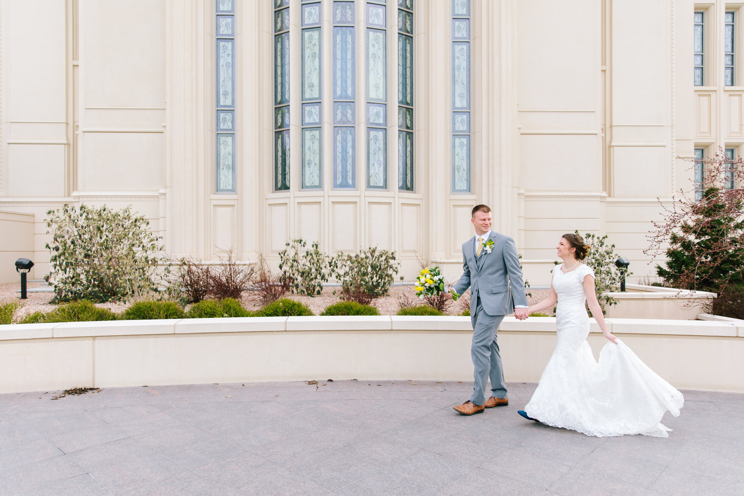 bright and airy wedding day pictures groom leading the bride payson temple temple grounds utah couple beautiful wedding dress amazing couple stain glass windows payson temple walls the church of Jesus Christ of latter day saints wedding eternal best buddies #eternalbuddies #weddingsession #weddinginspo #ldswedding #ldsbride #couplegoals #paysontemple #temple #profressionalphotographer #utah #love
