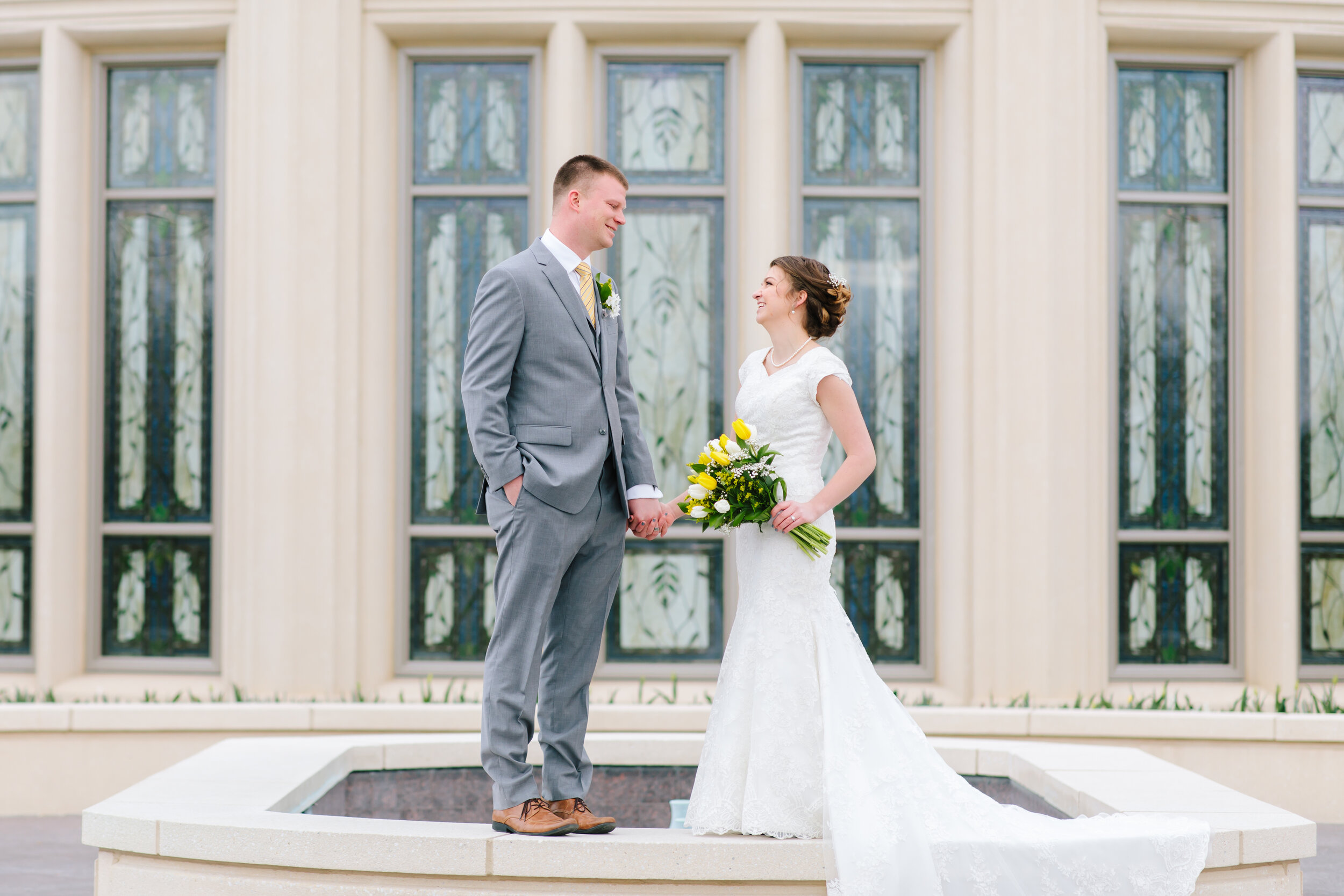 payson temple grounds beautiful stained glass amazing marble lovebirds tulip bouquet tie matching bouquet couple holding hands pose inspiration great grey suit groom outfit inspiration lds couple lovely couple bride and groom perfect match utah brides bridals #eternalbuddies #weddingsession #weddinginspo #ldswedding #ldsbride #couplegoals #paysontemple #temple #profressionalphotographer #utah #love