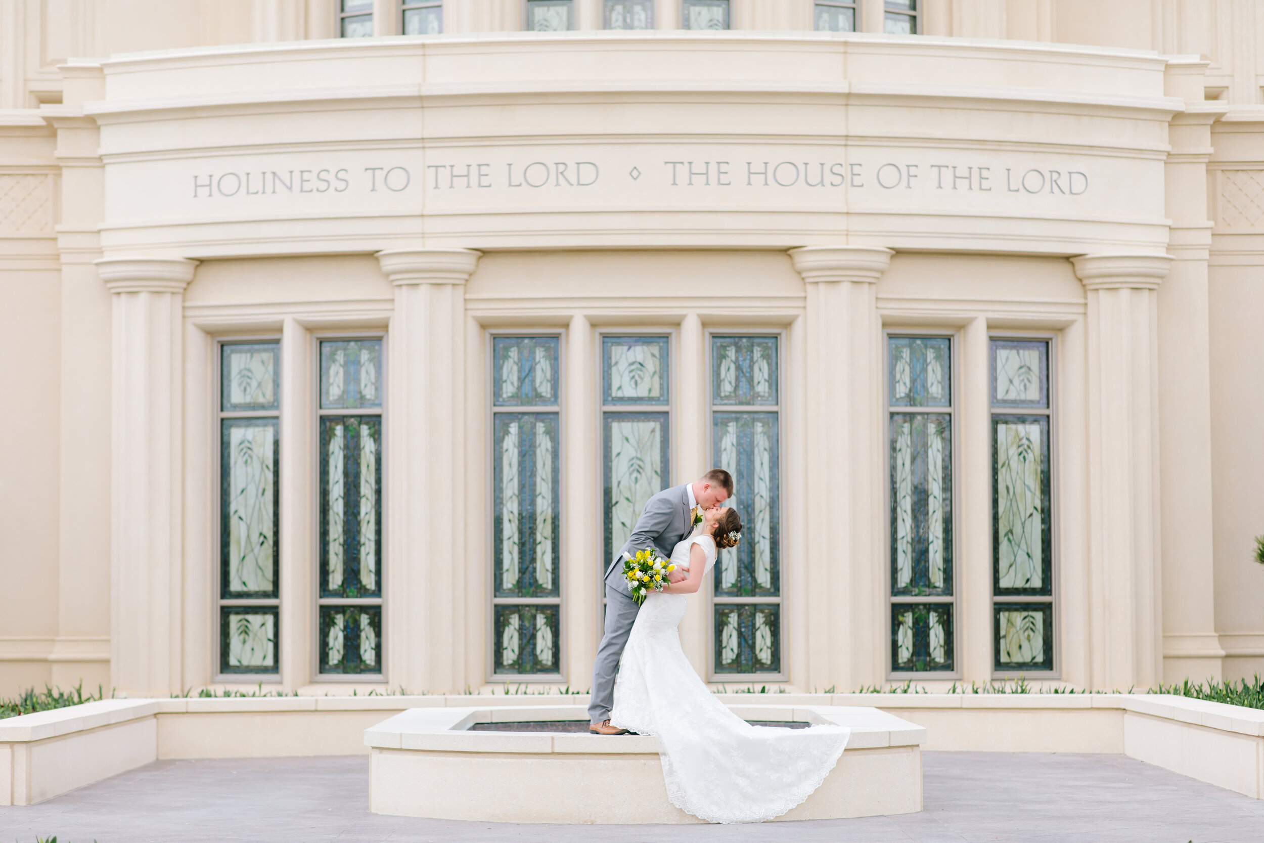 standing kissing dip pose inspiration wedding day picture inspiration lds temple payson temple lds couple mormon bride modest wedding dress inspiration temple ground photo shoot utah photographer couple goals payson utah temple wedding picture inspiration lds #eternalbuddies #weddingsession #weddinginspo #ldswedding #ldsbride #couplegoals #paysontemple #temple #profressionalphotographer #utah #love