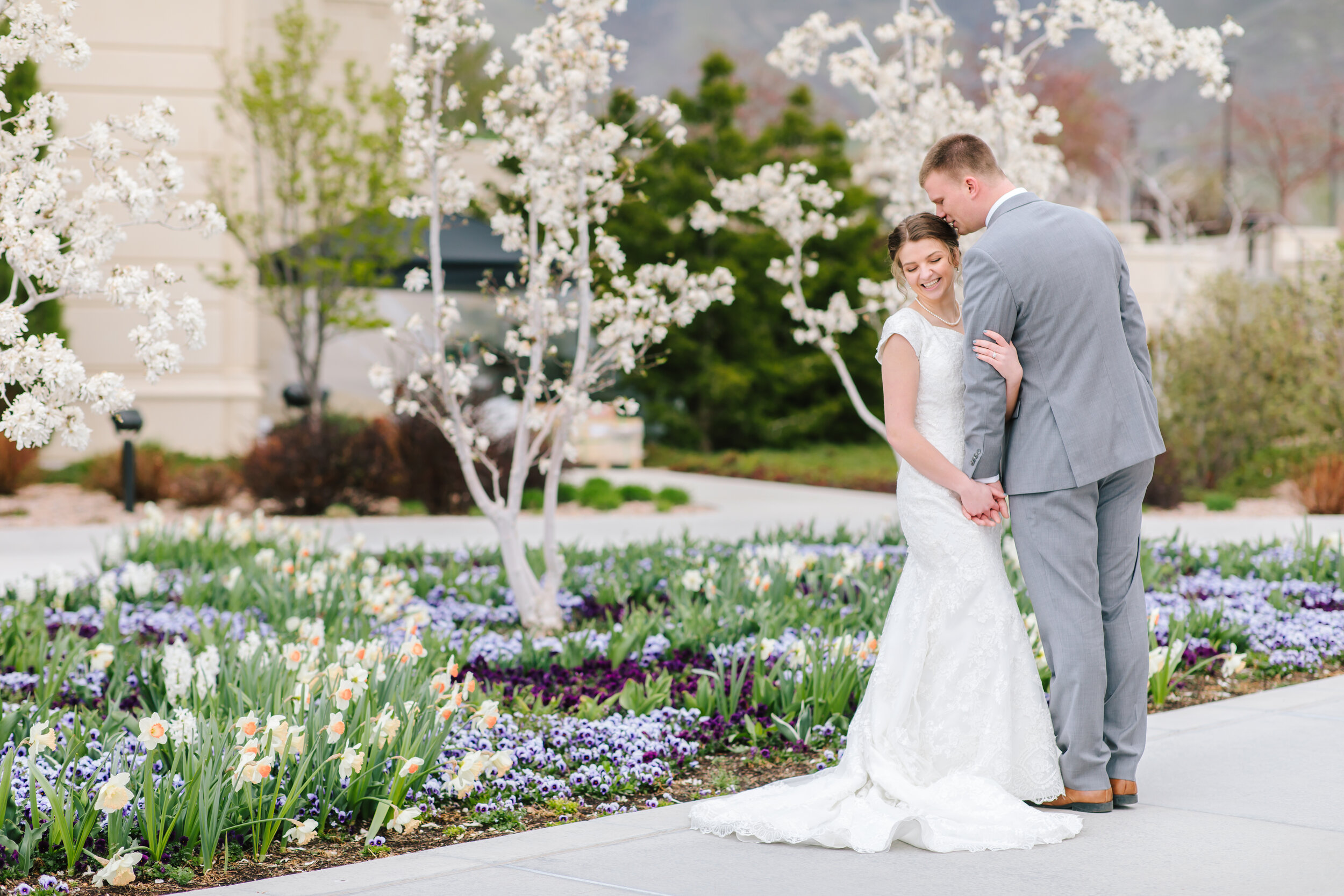 modest wedding dress inspiration lace wedding dress tulip sleeved wedding dress couple pose inspiration husband and wife grey suit mens wedding outfit inspiration payson temple grounds lds temple beautiful flowers men and women wedding outfit inspiration lds bridals bridal session #weddingsession #weddinginspo #ldswedding #ldsbride #couplegoals #paysontemple #temple #profressionalphotographer #utah #love