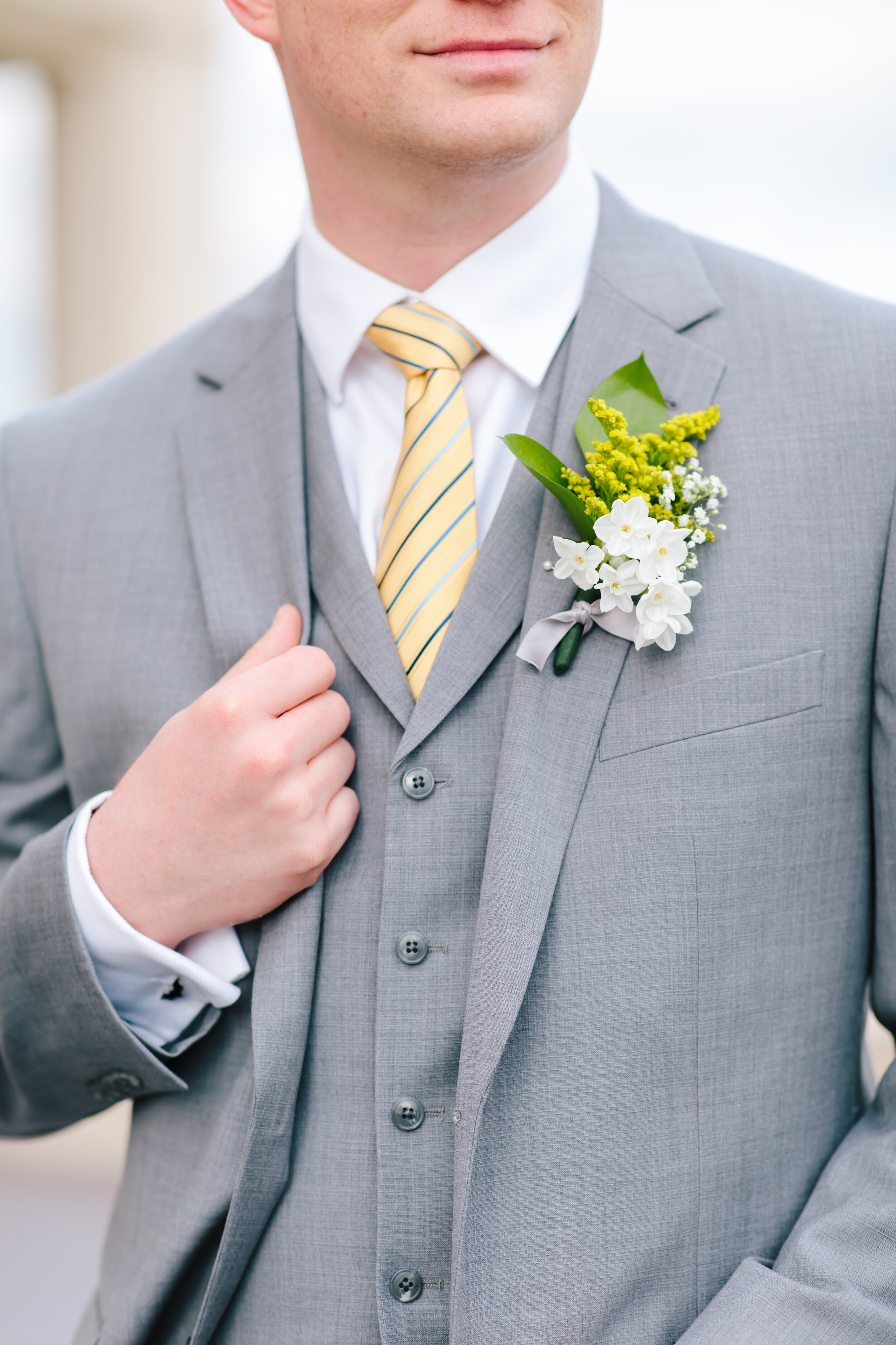 light grey suit mens wedding outfit inspiration yellow tie white and yellow wedding colors boutonniere ideas wedding inspiration groom pose inspiration lds wedding inspiration lds couple lds bride inspiration for groom utah couples professional wedding session clarity lane #weddingsession #weddinginspo #ldswedding #ldsbride #couplegoals #paysontemple #temple #profressionalphotographer #utah #love