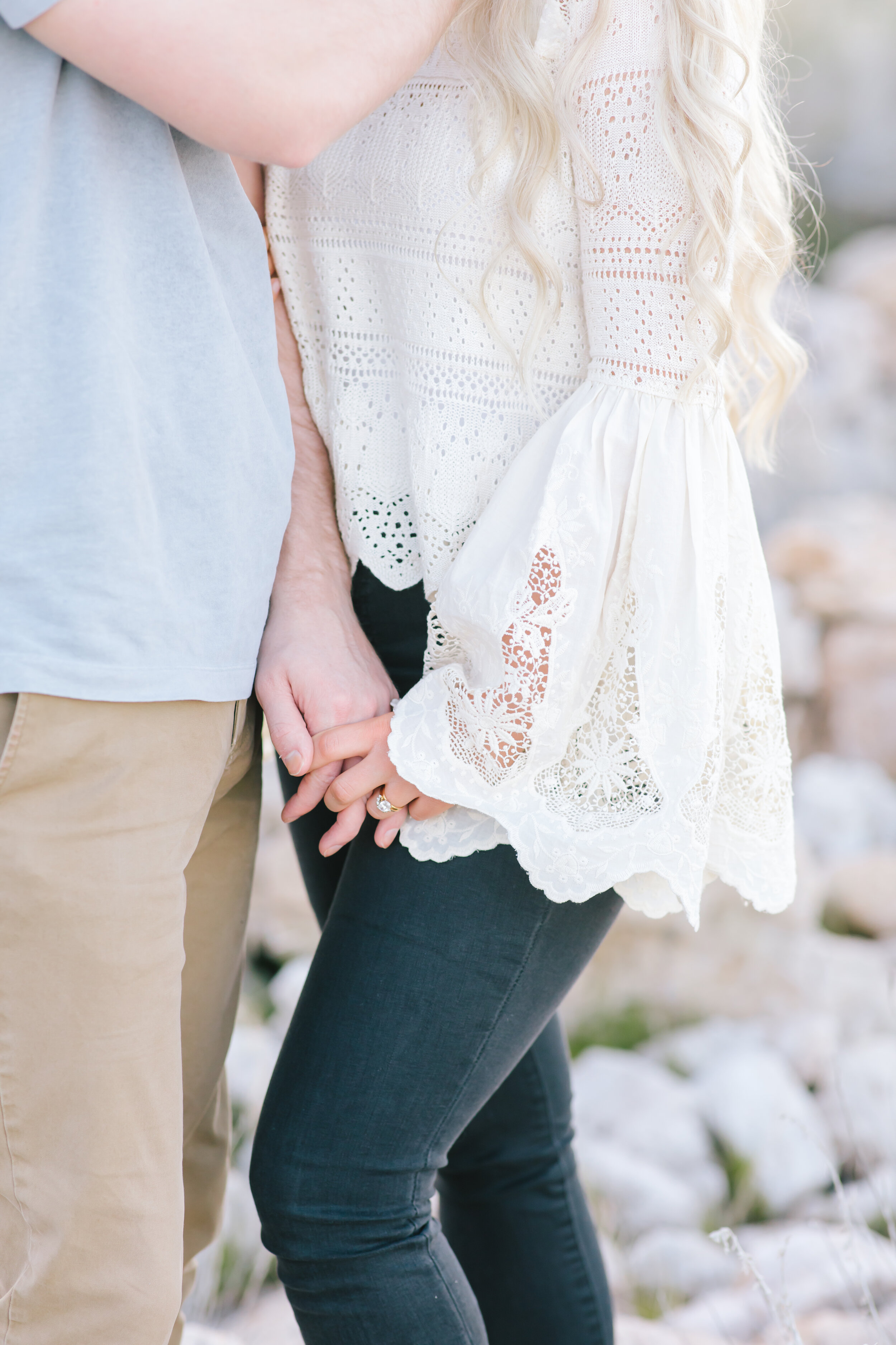 close up holding hands natural hand positioning inspiration wedding ring simple intimate naturally show the ring pose inspiration elegant bright casual couple outfit inspiration close up engagement photo shoot goals utah couple professional photographer perfect lighting #antelopeisland #couplekissing #engagementoutfitinspo #locationinspo #romantic #outside #engagementposes #engagementideas #weddingring