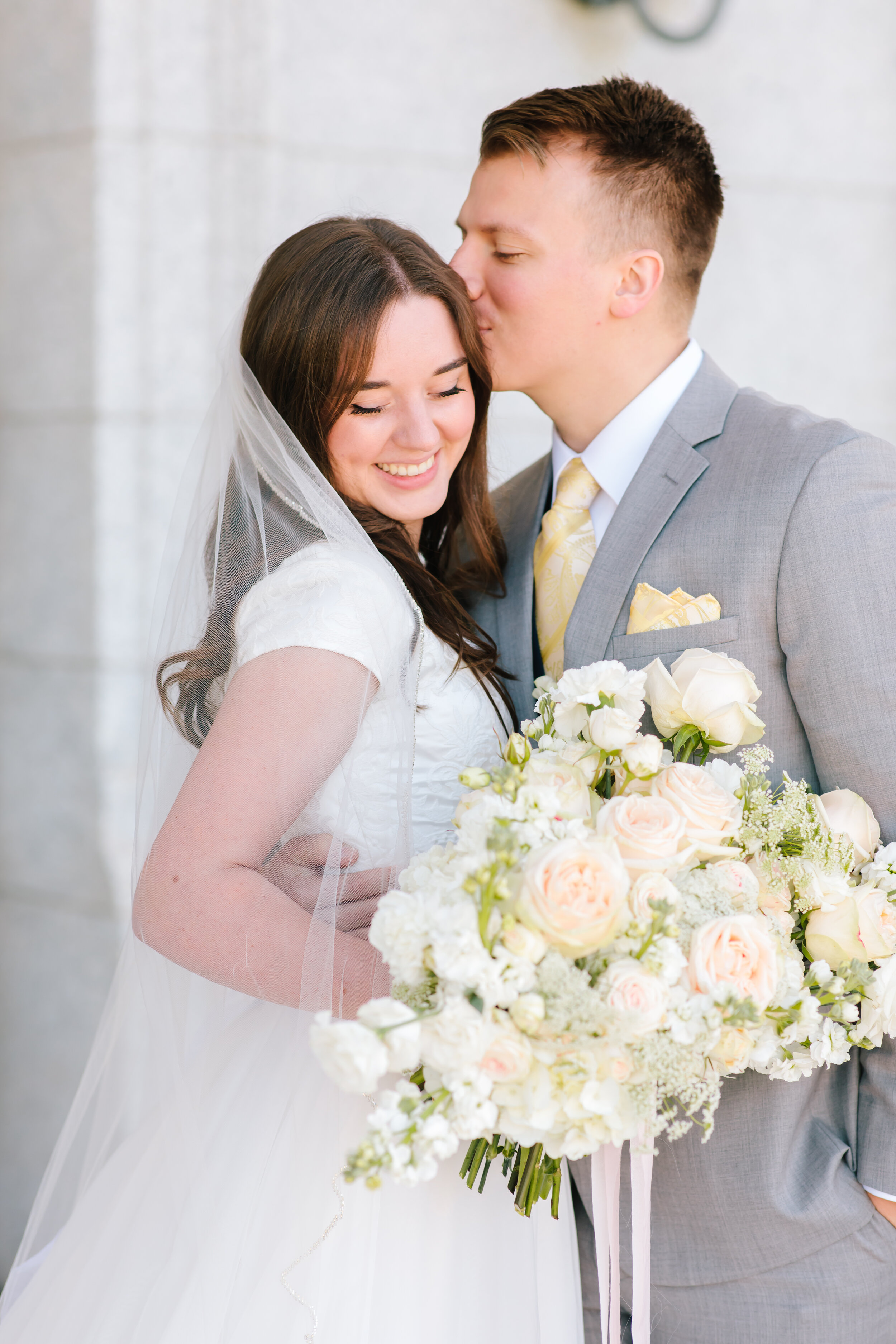 adorable kissing forehead couple pose inspiration early morning formal photo shoot session beautiful bride bridal attire inspiration modest wedding dress inspiration wedding veil inspiration beautiful white bouquet bouquet inspiration salt lake capital building photo shoot love #formals #saltlakecity #capitalbuilding #lovebirds #couplegoals #bridal #weddinginspo #wedding #professional #photographer