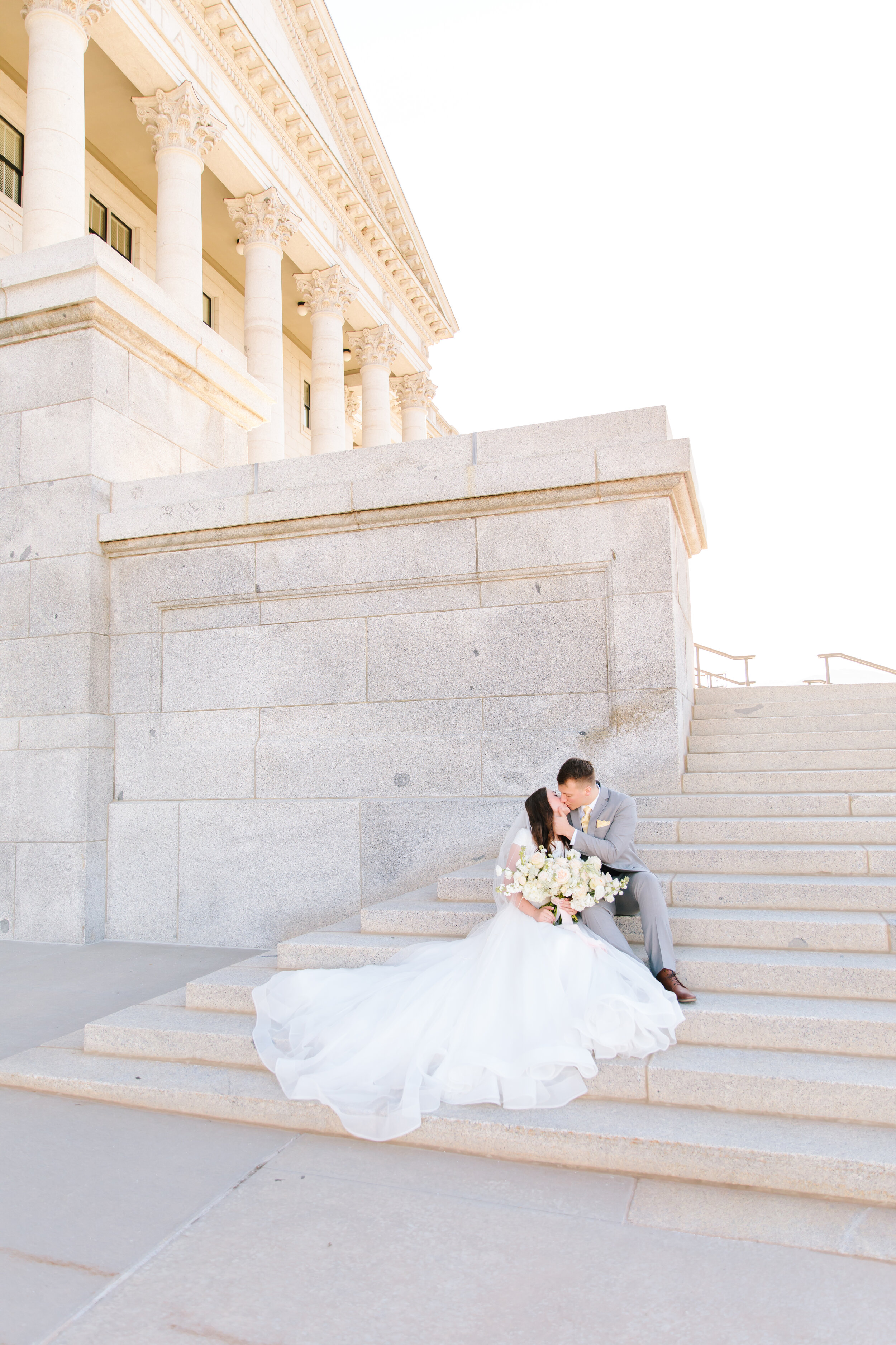 showing off the wedding dress skirt a line dress inspiration couple pose on the steps inspiration capital building background wedding picture goals photography inspiration early morning sunrise photo shoot beautiful architecture utah architecture formal wedding session couple   #formals #saltlakecity #capitalbuilding #lovebirds #couplegoals #bridal #weddinginspo #wedding #professional #photographer