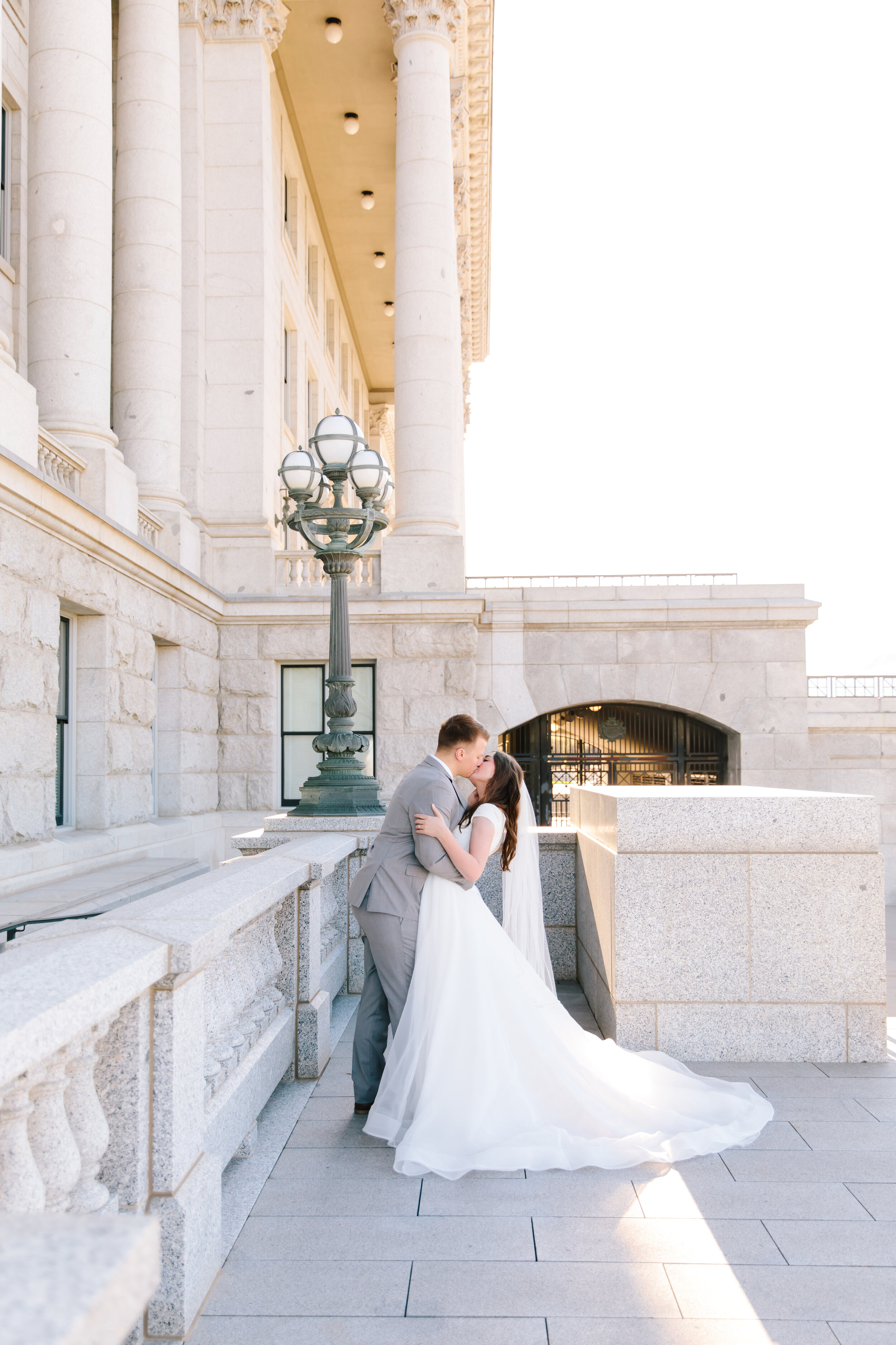standing by the lamp post slight dip couples pose inspiration romantic scenery romantic couple beautiful couple soon to be man and wife beautiful light and airy glowing couple so in love true love couple goals wedding inspiration morning professional photo shoot formals love #formals #saltlakecity #capitalbuilding #lovebirds #couplegoals #bridal #weddinginspo #wedding #professional #photographer