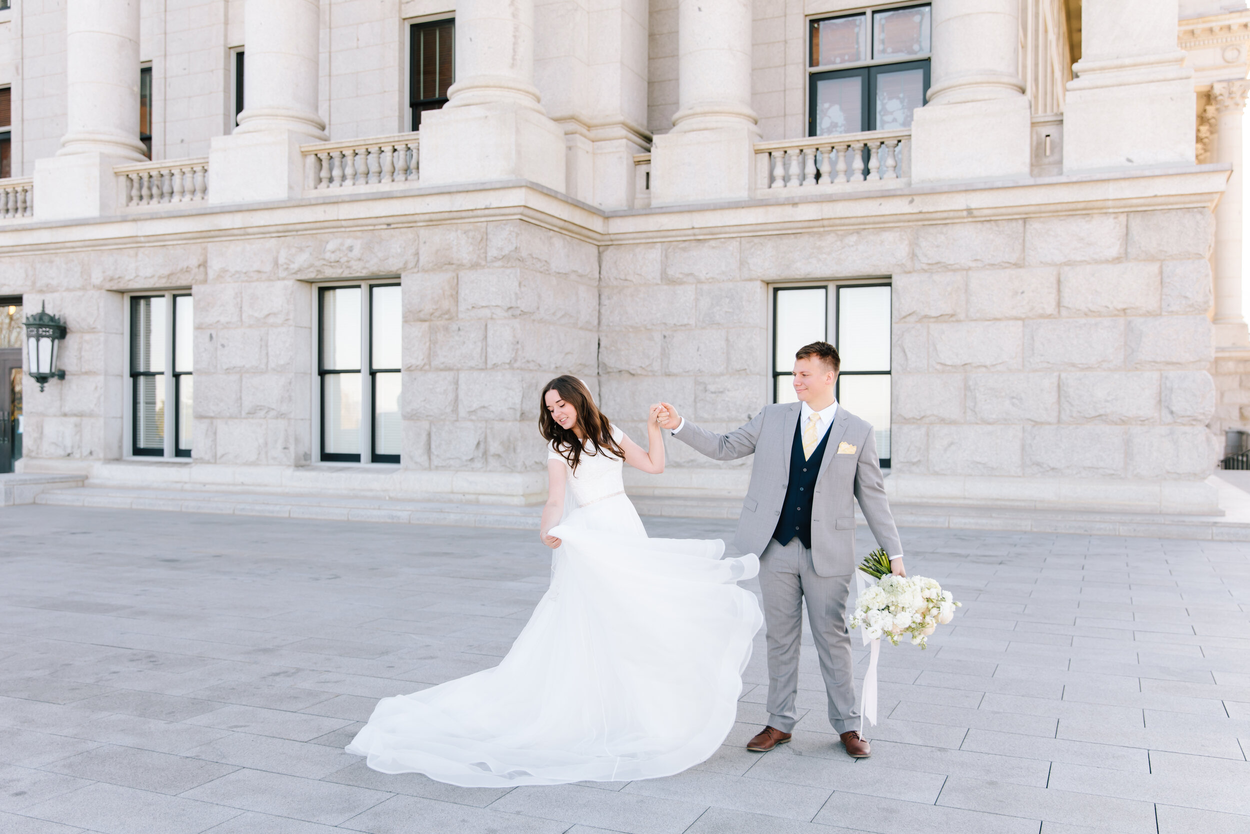 couple dancing flowing wedding dress skirt gorgeous moment captures beautiful bride couple inspiration spin the bride mens wedding attire inspiration wedding outfit for men grey suit dark turquoise vest yellow tie and handkerchief professional formal photography mens dark brown shoes #formals #saltlakecity #capitalbuilding #lovebirds #couplegoals #bridal #weddinginspo #wedding #professional #photographer