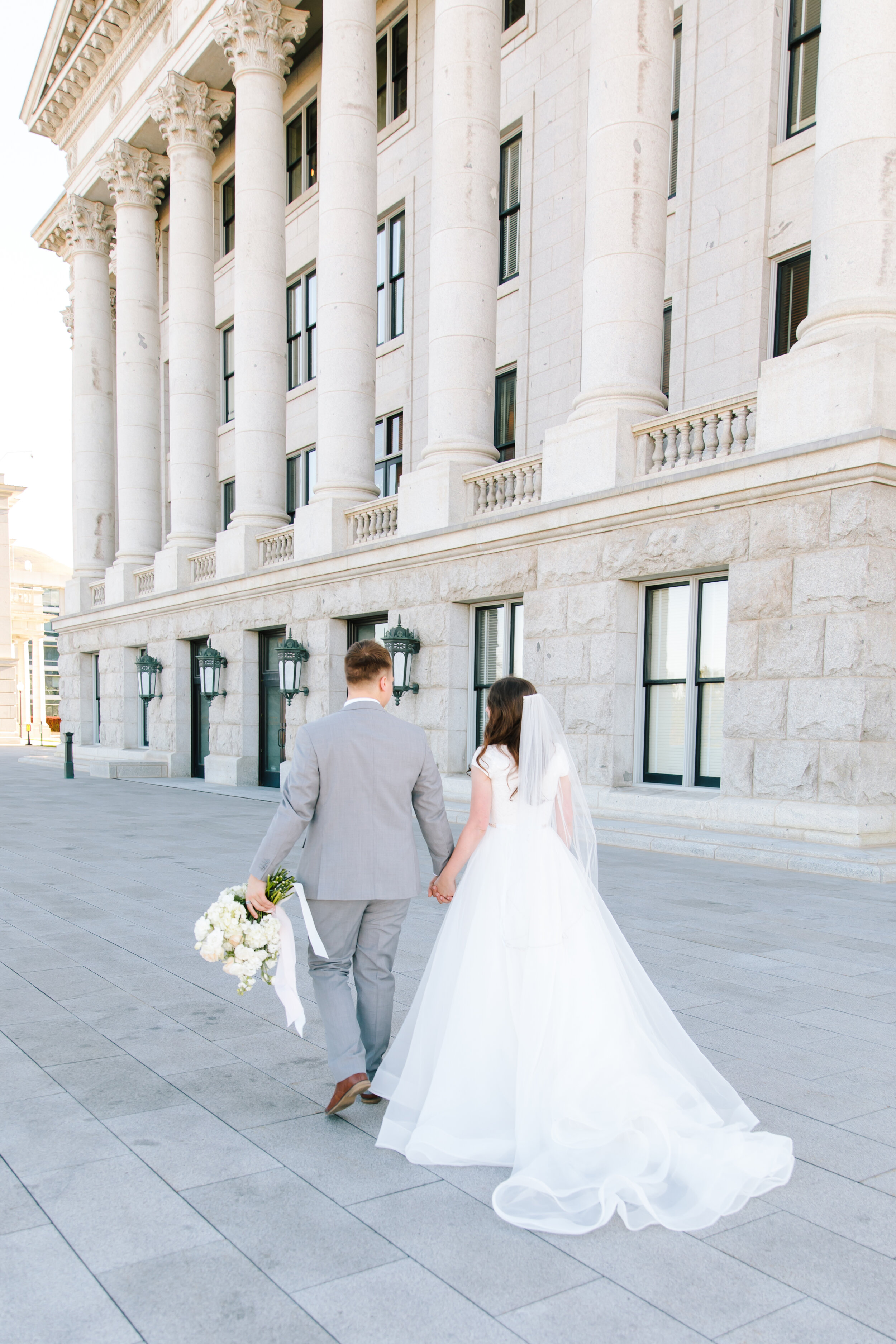 beautiful early morning summer session inspiration couple walking hand in hand beautiful capital building modes lds wedding attire lds wedding inspiration location photo shoot beautiful white glowing soft colors photo shoot inspiration photo shoot goals professional photographer #formals #saltlakecity #capitalbuilding #lovebirds #couplegoals #bridal #weddinginspo #wedding #professional #photographer