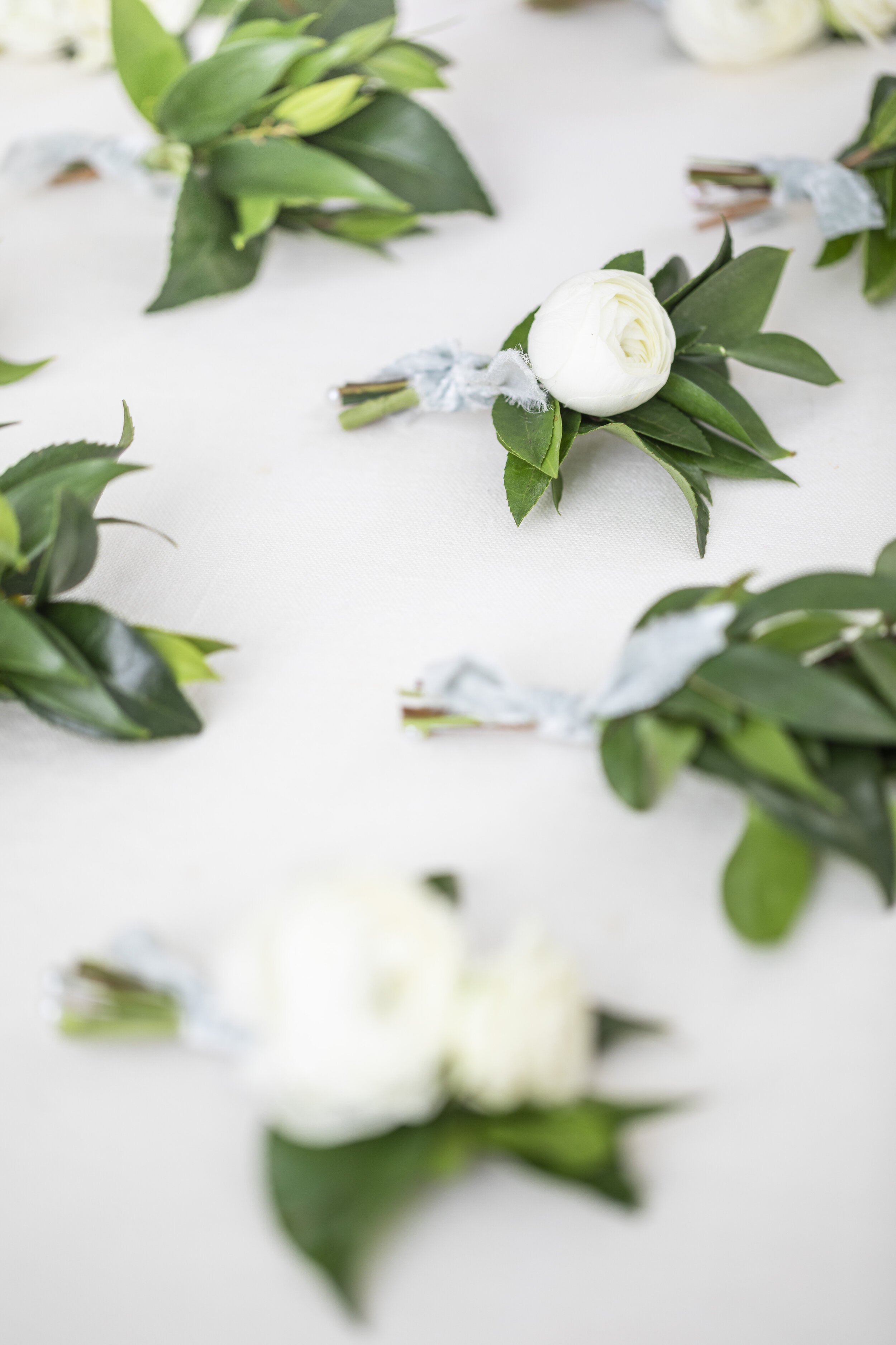 simple elegant one white flower boutonniere inspiration wedding day inspiration wedding boutonniere goals beautiful boutonniere simple and elegant florist goals wedding goals reach out to your florist three to four months before your beautiful big day florist tips tricks and hacks #floristtips #tipsandtricks #vendorspotlight #blushingrosefloral #florist #utahcounty #wedding #inspiration #help #flowers