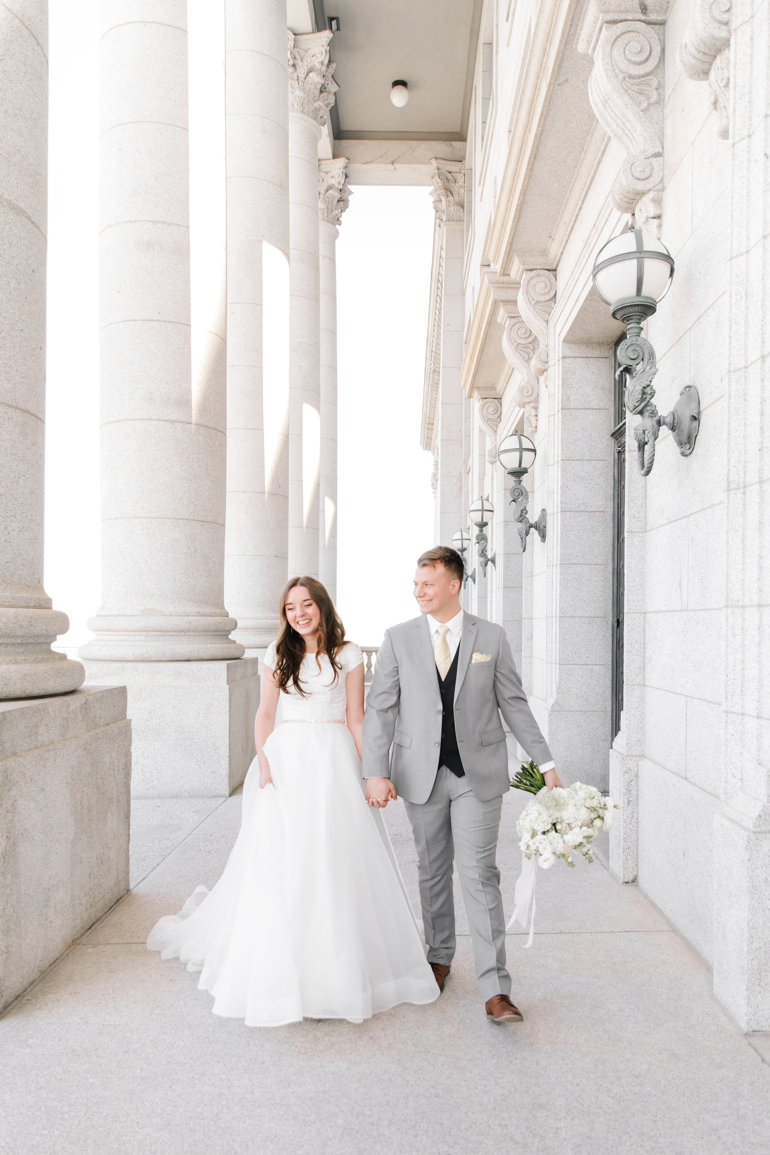 bright and clean sophisticated bridals wedding photography style utah state capitol savanna with clarity lane professional wedding photography available for travel outside of utah modest wedding gown lds wedding photographer