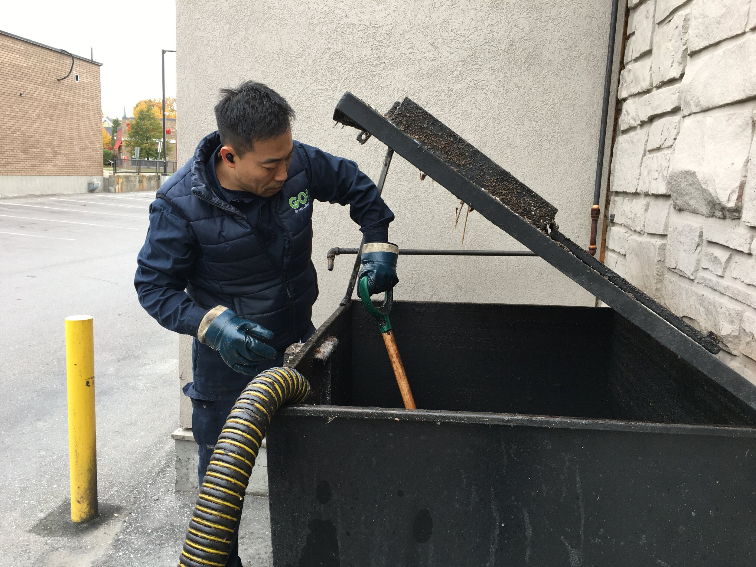 Sometimes our drivers will use a shovel to speed up the oil suction process and to clear the hardened oil clumps that usually sink to the bottom of the bins.