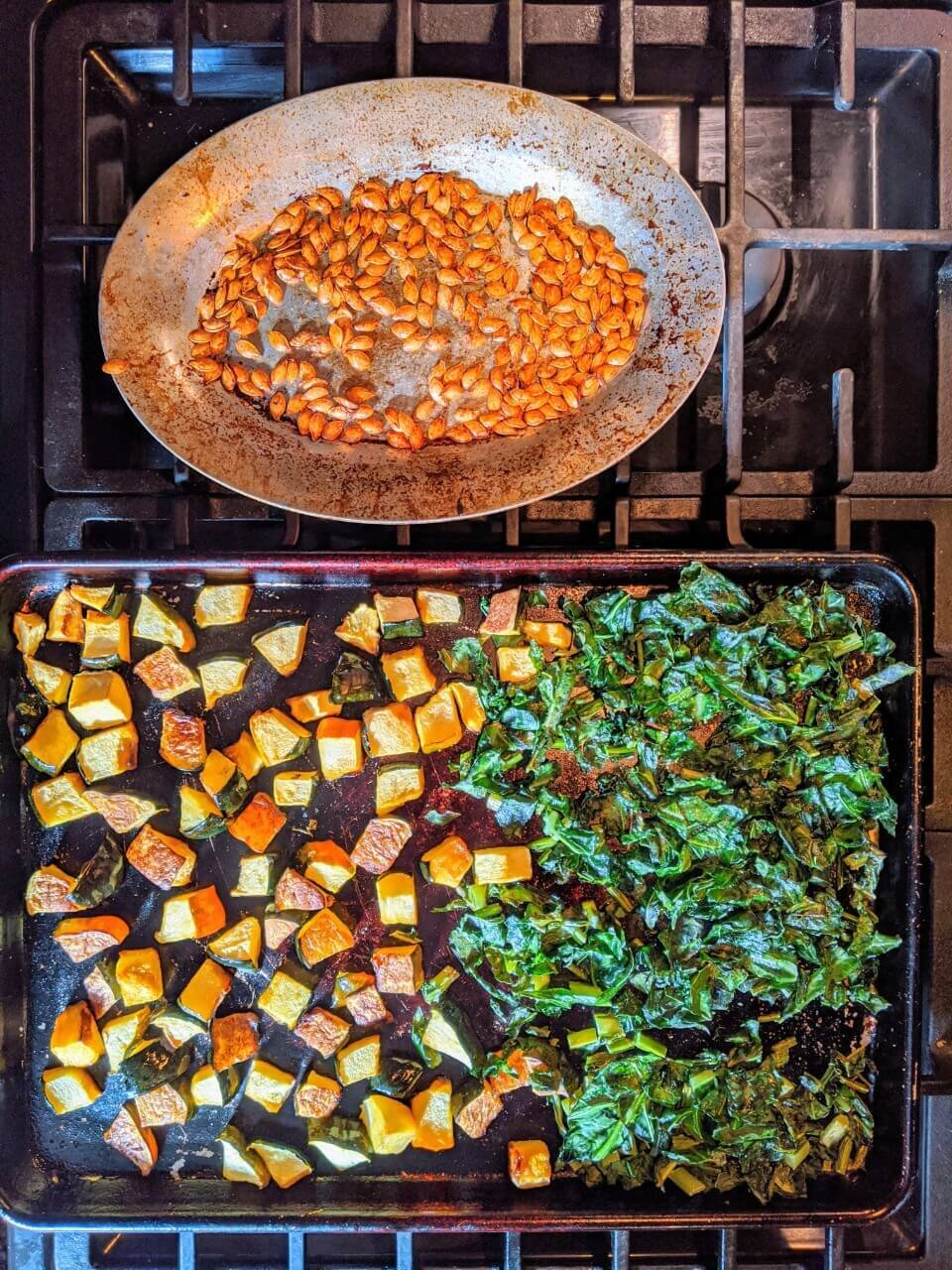 Roasted acorn squash, collards, and acorn squash seeds for adding to the    Winter Grain Bowl with Squash and Wild Rice   .