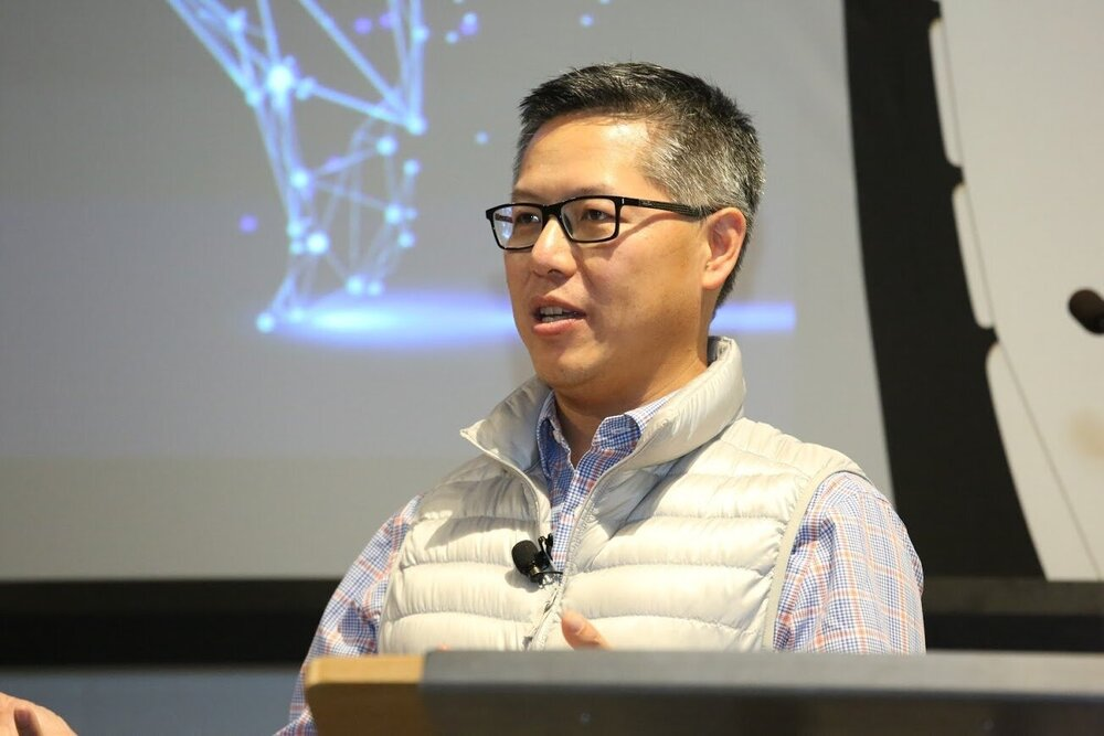 Erich Huang speaking during a presentation