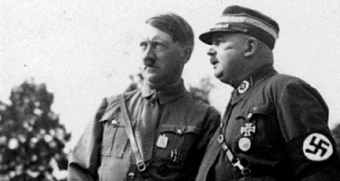 """Hitler with his close friend Ernst Röhm (1887 –  1934), one of the members of the German Workers' Party, and a co-founder of the Sturmabteilung (SA, """"Storm Battalion"""")."""