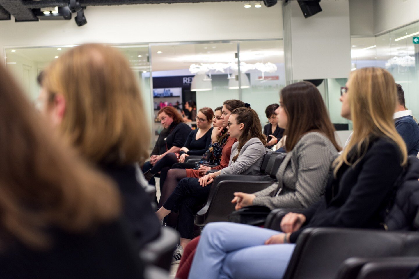 Audience members at L'oreal International Women's Day event
