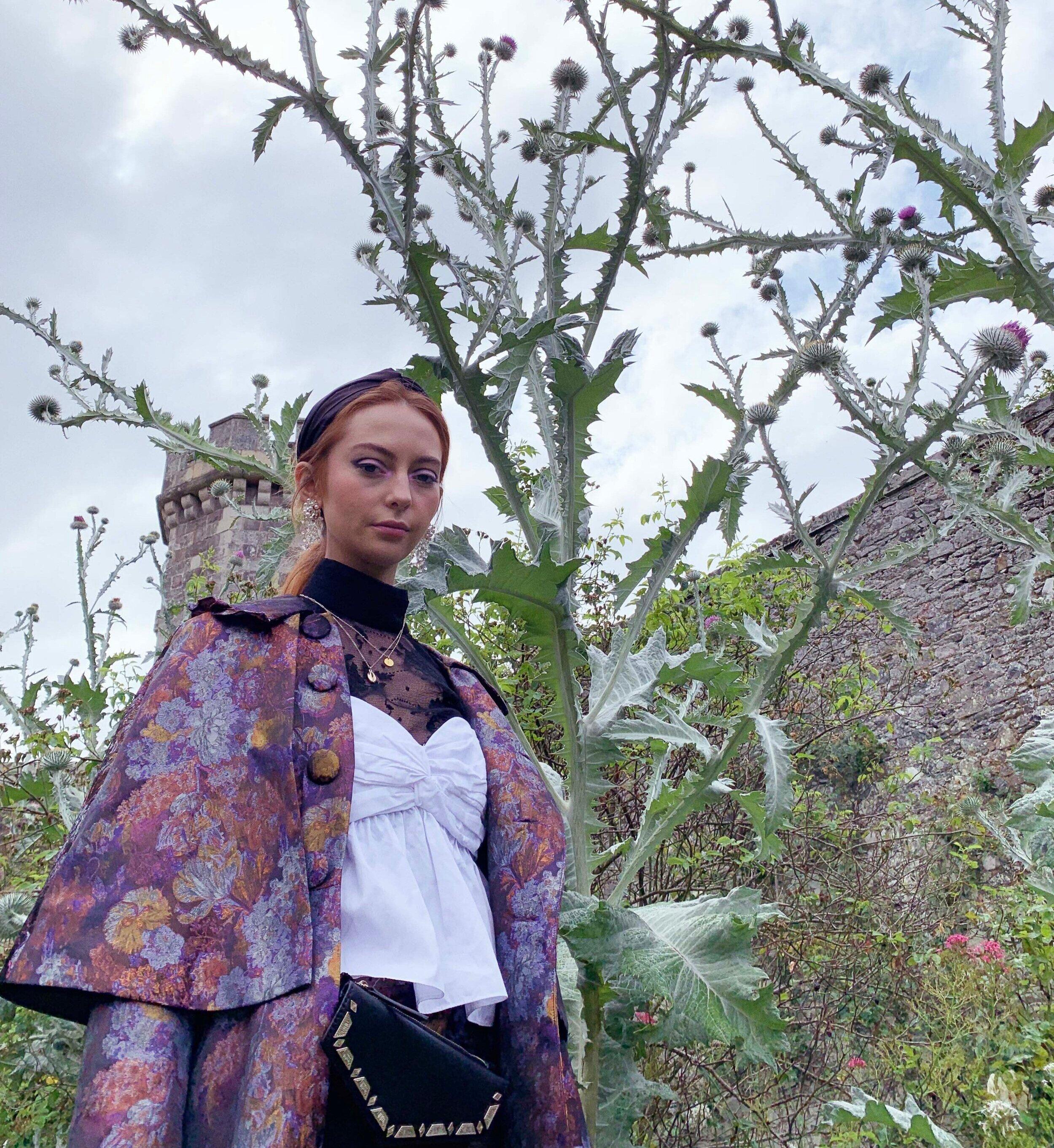 Logan in Scotland wearing the Witchery Coat in Brocade
