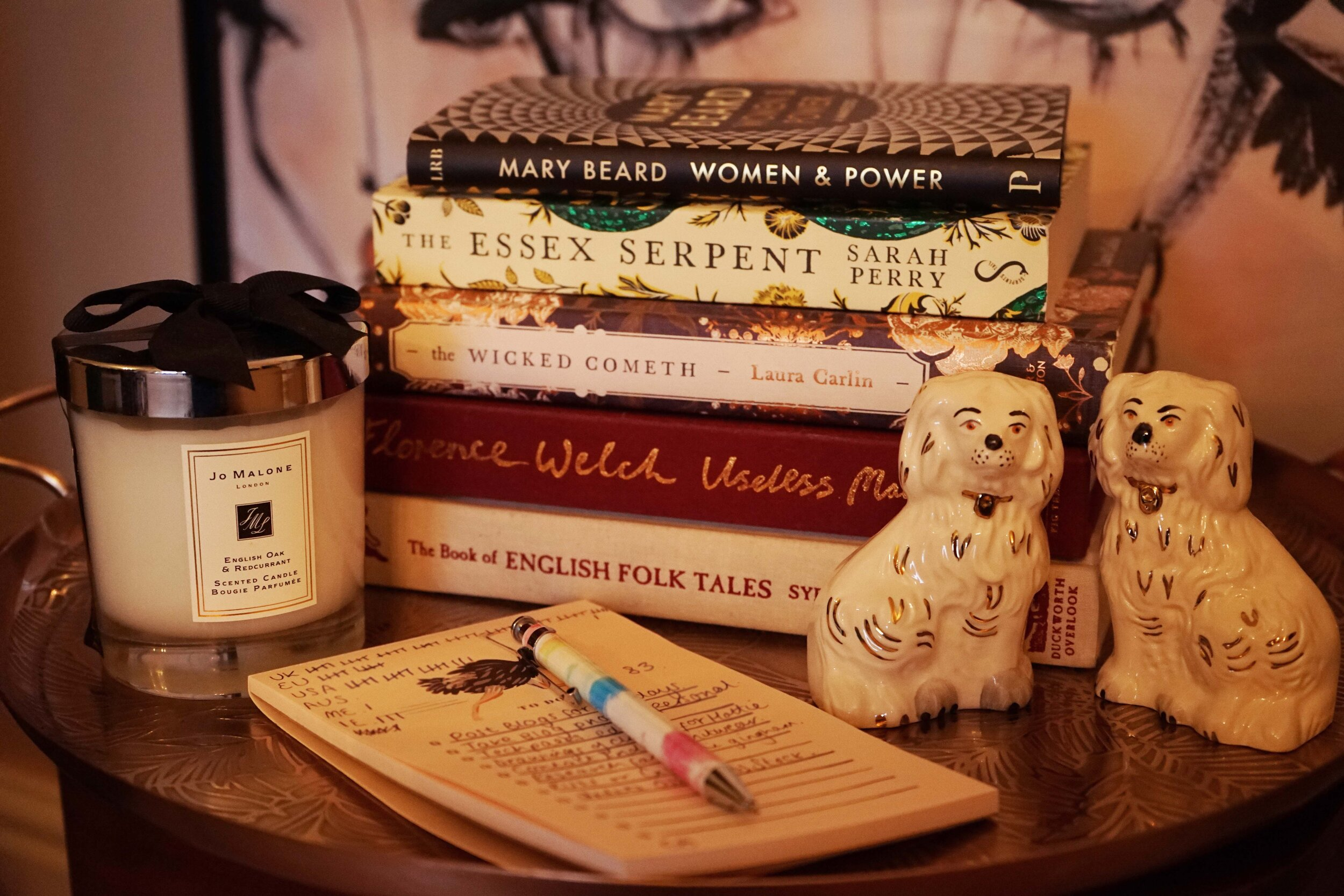 My coffee table is usually stacked with books yet to read, notes, favourite candles and my vintage Royal Doulton dogs, a gift from my sister.