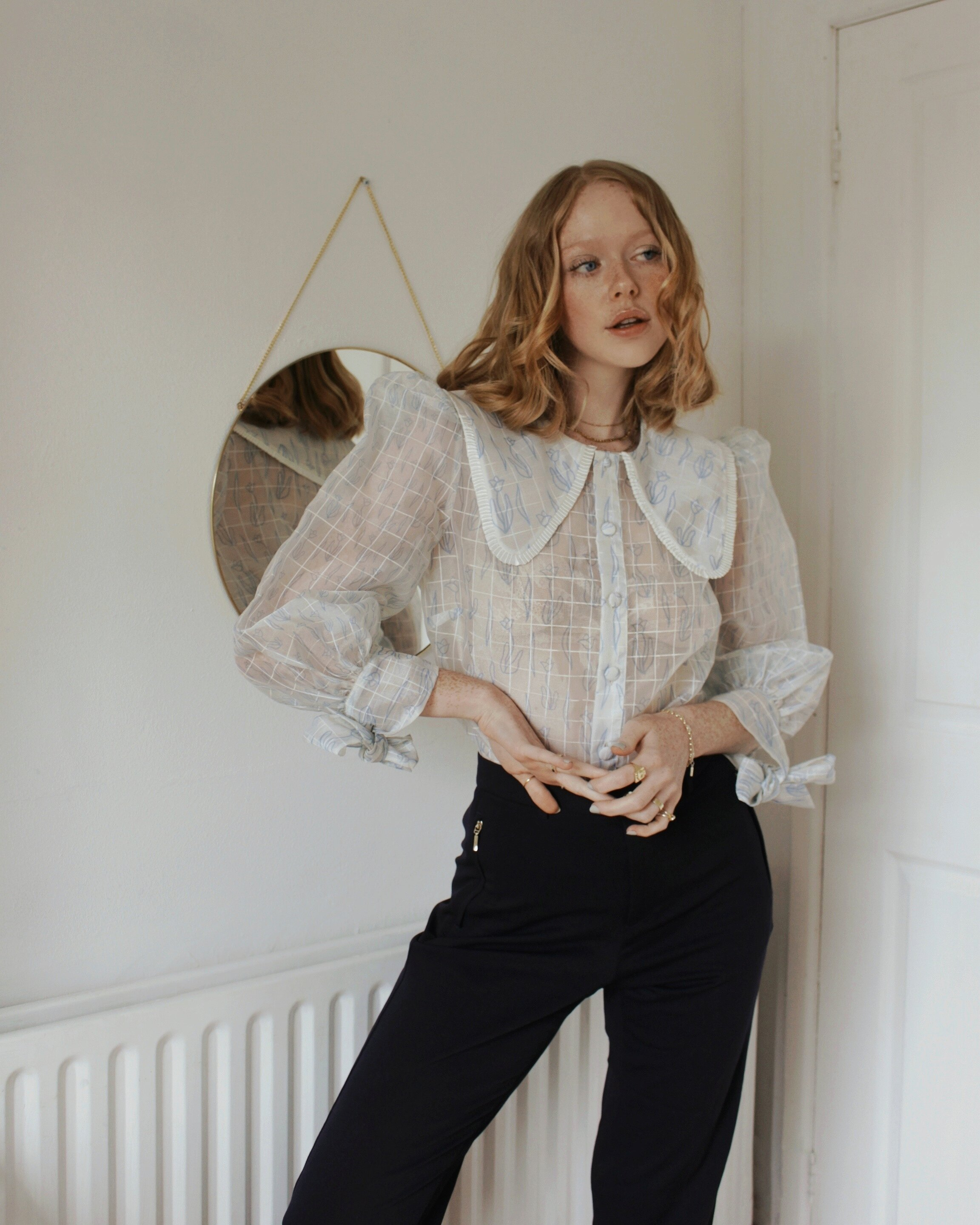 What is your most loved Olivia Annabelle piece?   My favourite OA piece is definitely the  Clive Tulip Blouse  – I love the statement collar and puffed sleeve detail – it's so so beautiful!   What is your style aesthetic?   My style is quite minimal. I love neutral pieces, but I love things that have a bit of 'extra' to them too. I love smart trousers with wide exaggerated legs, or blouses that have ruching or sleeve details. I like a classic style but with a modern twist.   What trends are you loving right now?   My favourite trend at the moment is definitely statement collars. I love seeing shirts with large pointed collars and blouses with embroidered necklines. I'm also really loving organza-everything too!