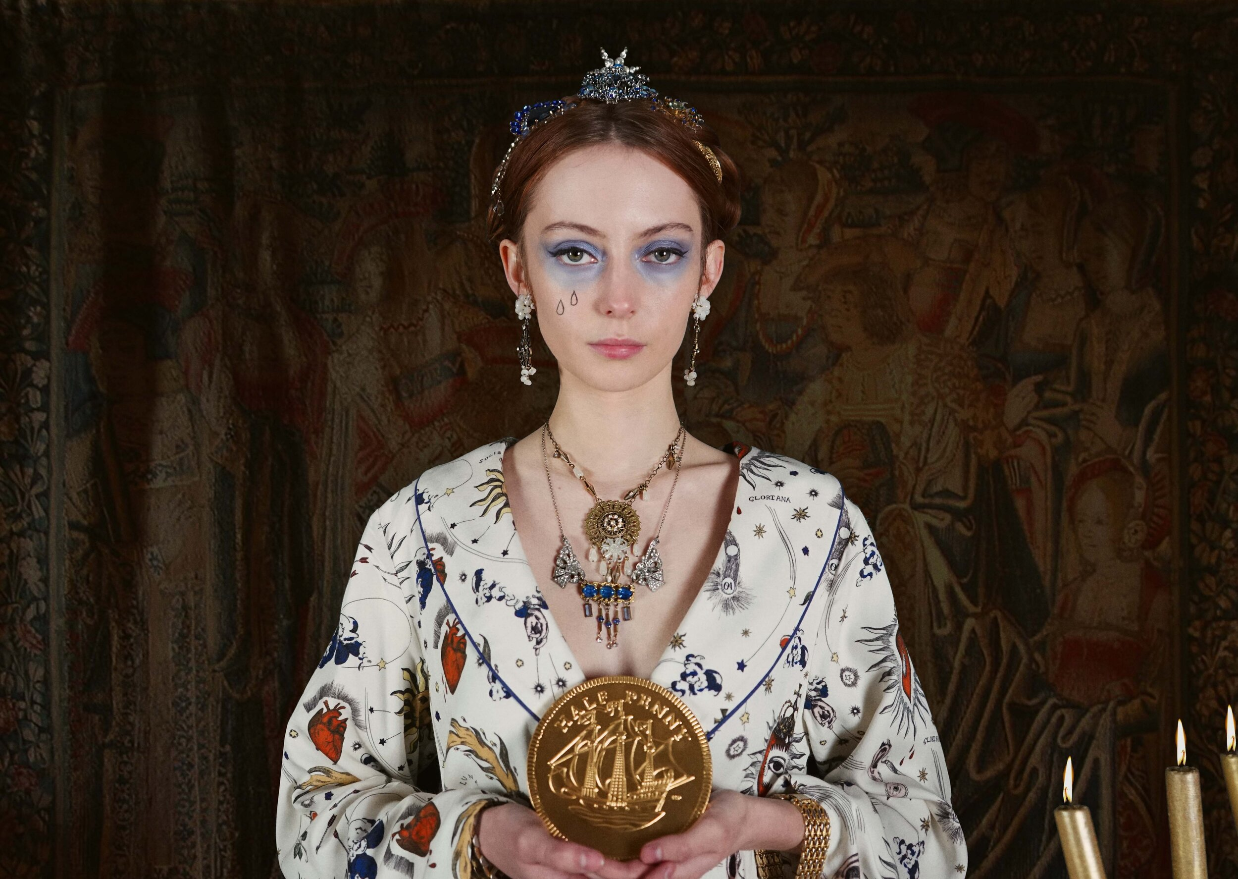 When planning the collaboration with Olivia Annabelle, where did you look for inspiration?    It was a perfect opportunity to look again at the great paintings of Queen Elizabeth I dressed in all her majestic finery, and to wider examples of Tudor jewellery to get a feel for the shapes and motifs which were popular. I also loved revisiting the costumes and styling of Cate Blanchett in the two films about Elizabeth. But I also wanted to bring a sense of timelessness to the collection and I wanted to reflect how our fascination with symbolic and statement jewellery has endured through the centuries. That's why it was important for me to use costume jewellery pieces from right across the 20th century – from the 1900s to the 1990s.   What is your favourite piece from the collection?   I absolutely loved putting the Gloriana Halo Crown together, starting with the Edwardian paste moon-shaped dress ornament and the Art Deco era paste star brooch, both which I already had in my stash of vintage treasures, and then sourcing the other pieces of vintage jewellery to echo the rich royal blue hue that runs through the Olivia Annabelle print. But I think my absolute favourite is the OA Eye, created from an oval early 20th century paste dress buckle. The design came to me in a flash of inspiration. I had all the little component pieces here in the studio and everything came together in such perfect harmony!   What led you to become a jewellery designer?   That's interesting and quite difficult to pinpoint as it happened almost accidentally. I have always enjoyed creative activities, but I took a more academic route at university, studying history, obtaining a PhD and becoming a researcher and university lecturer. When on maternity leave with my third daughter I decided that I wanted to explore more creative avenues and focused on how I might use my passion for vintage costume jewellery and treasure hunting at antiques markets and boot sales in this endeavour. Prompted by my cousin