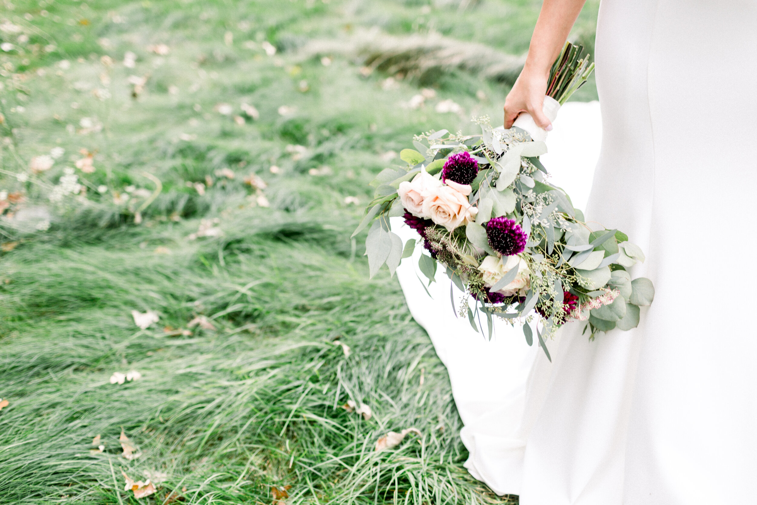 bride carrying hanging bouquet
