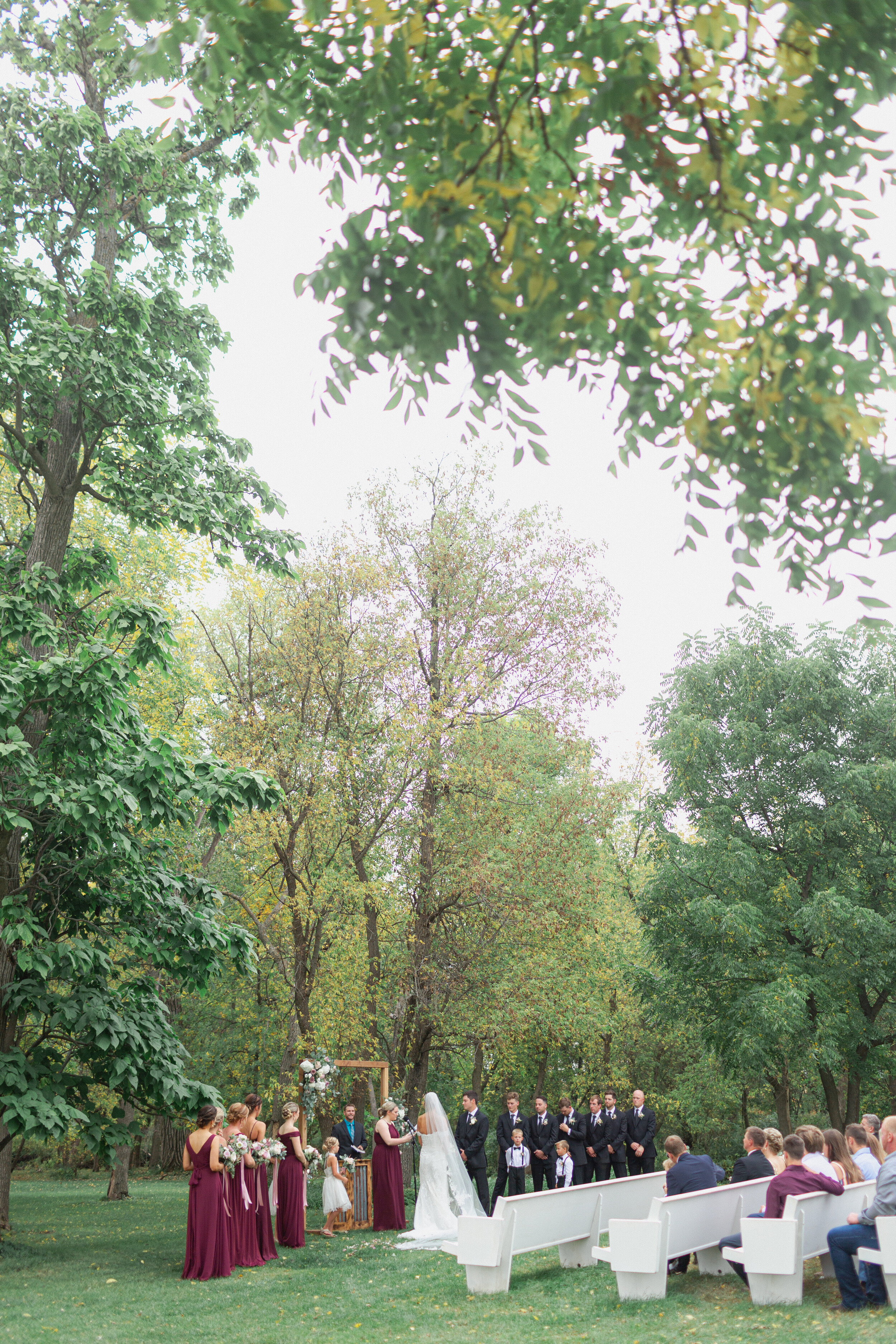 wedding ceremony by forest in Milwaukee