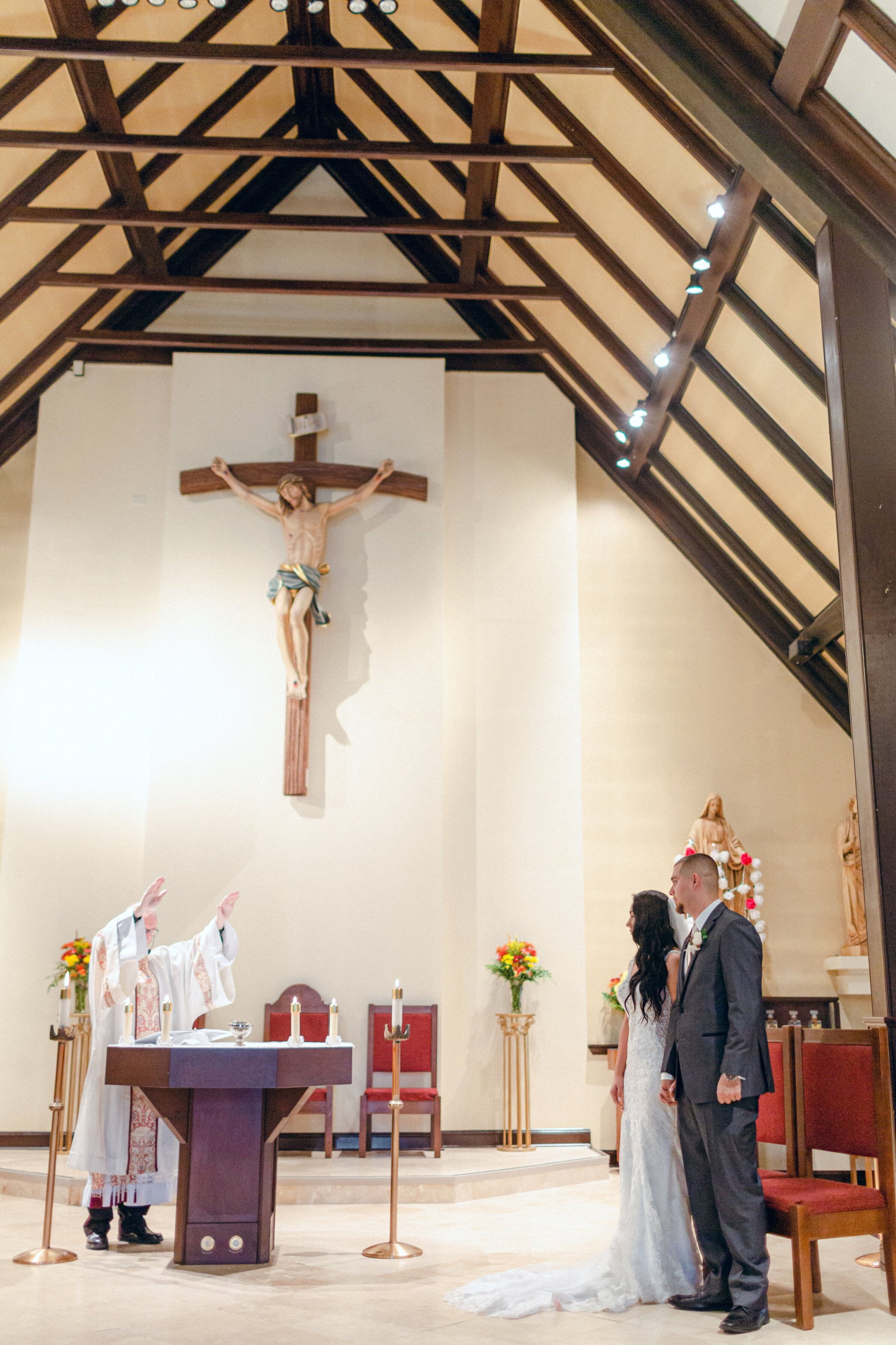bride+and+groom+being+blessed+at+alter+at+wedding+ceremony