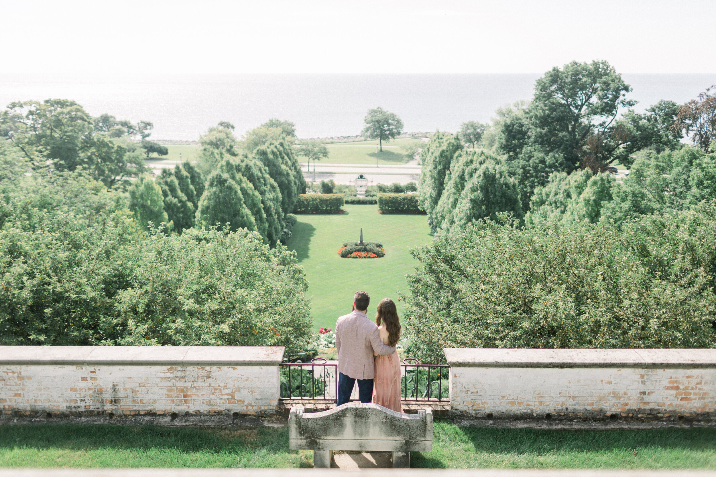 Couple on Villa Terrace balcony overlooking water