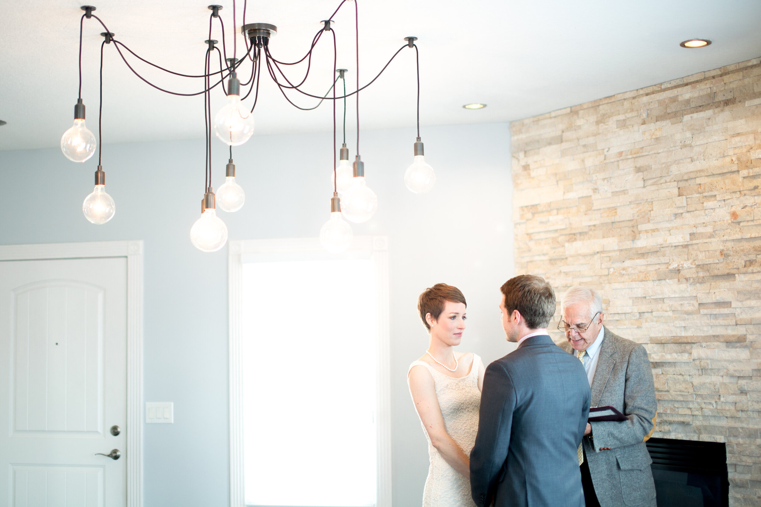 Intimate At Home Elopement of a Couple and Offcient