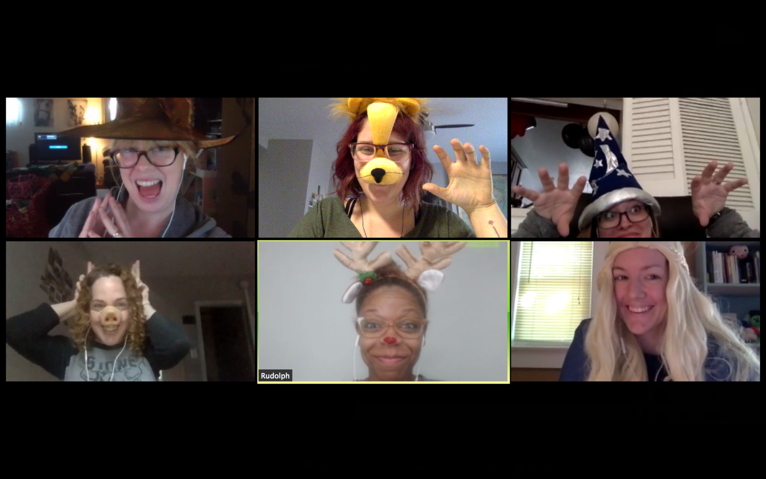 A few Skillcrush instructors celebrating Halloween during their daily check-in.