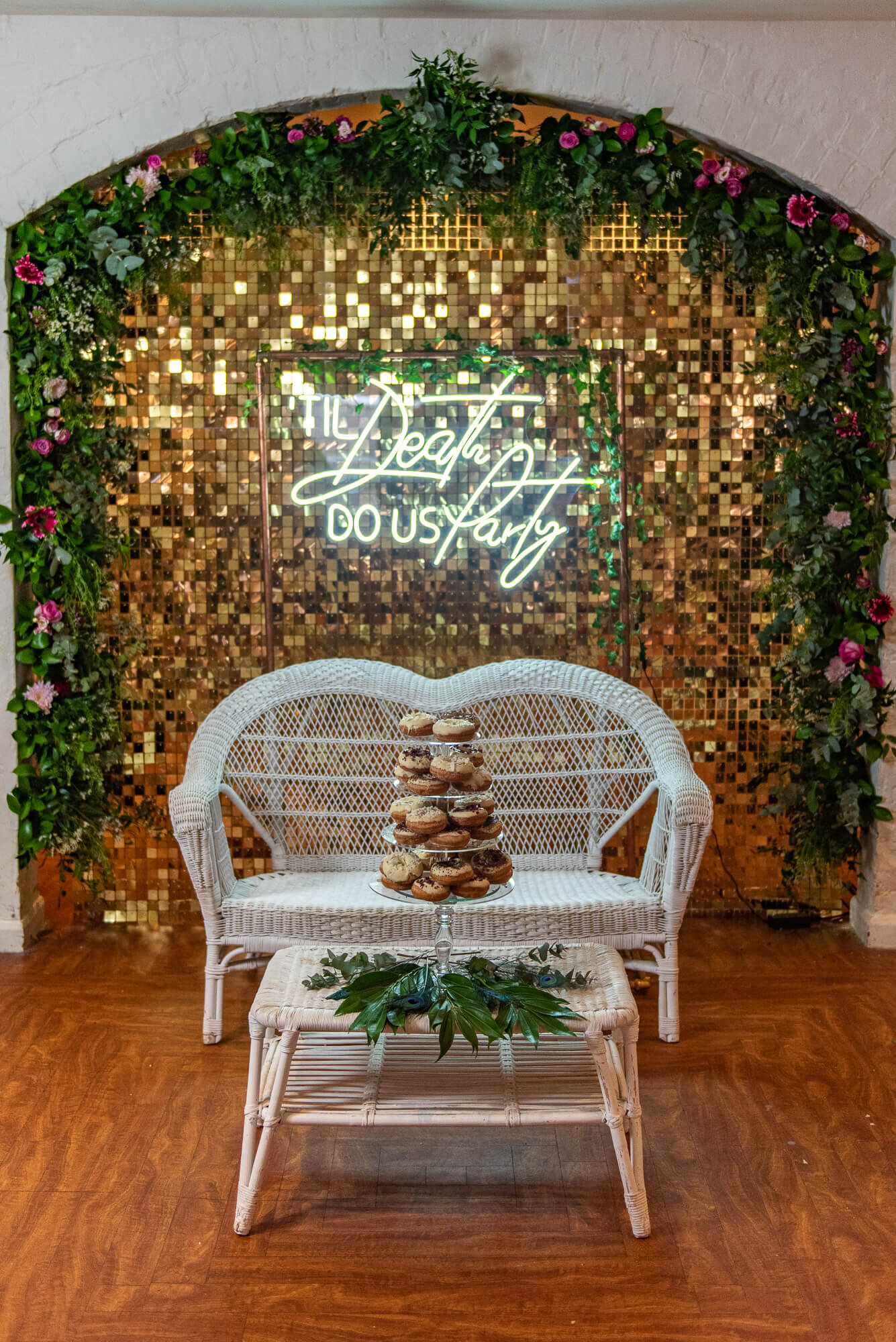 Til death do us party neon wedding sign with donut tower cake